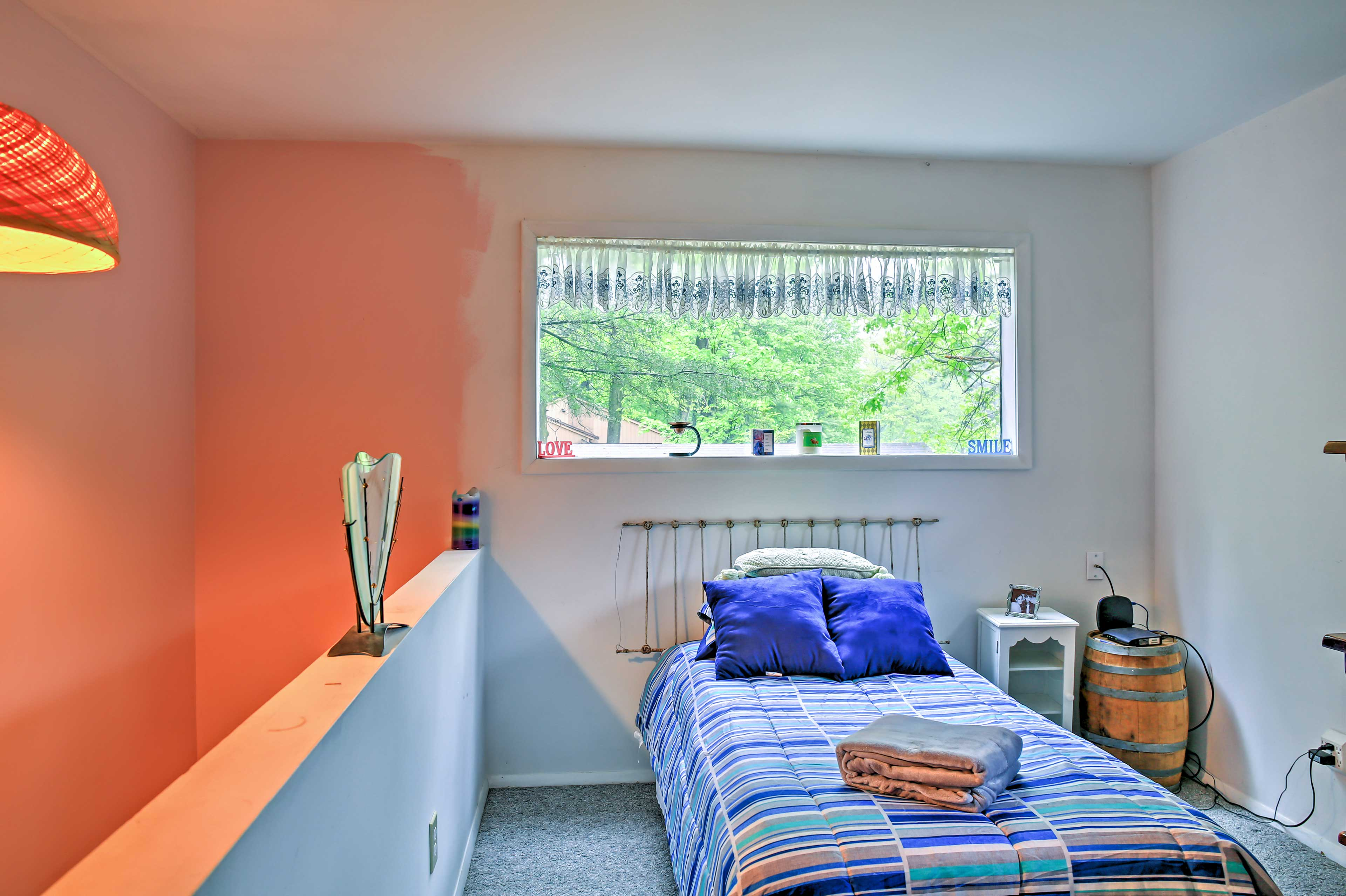 The loft bedroom offers a quiet space, desk and twin bed.