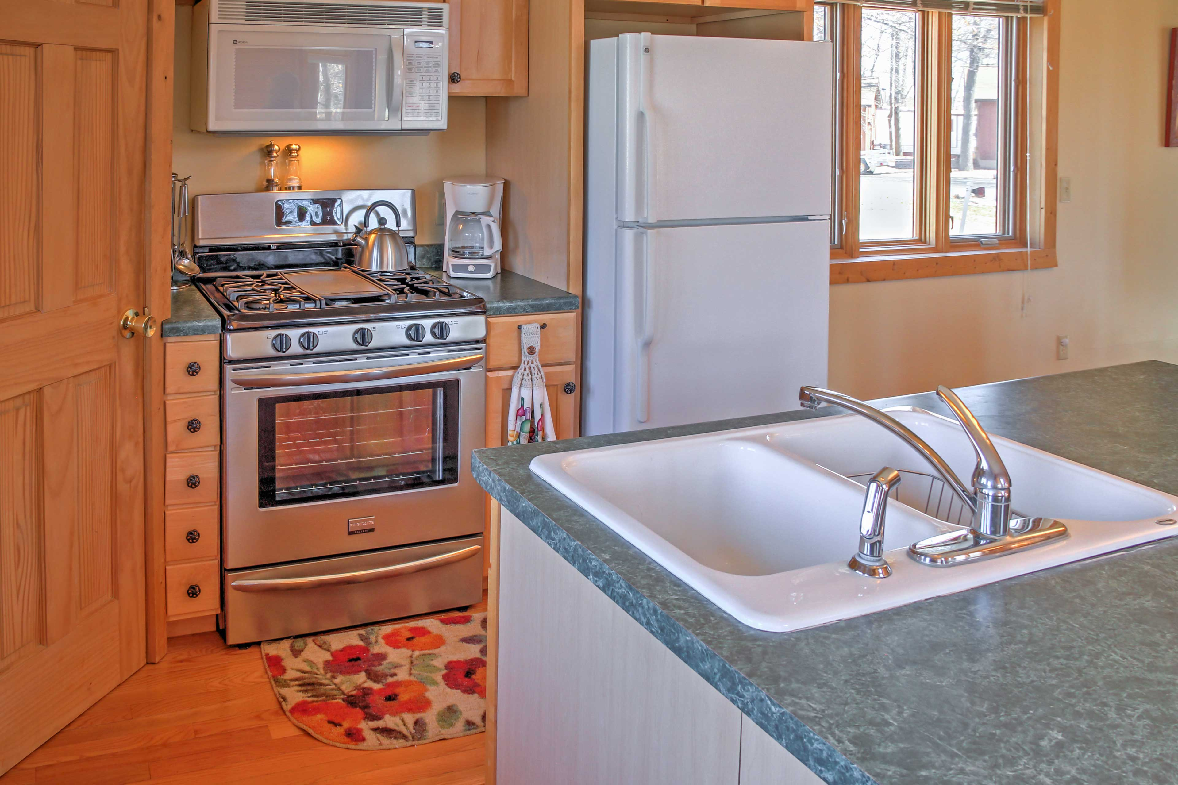 The kitchen is open to the dining and living area.