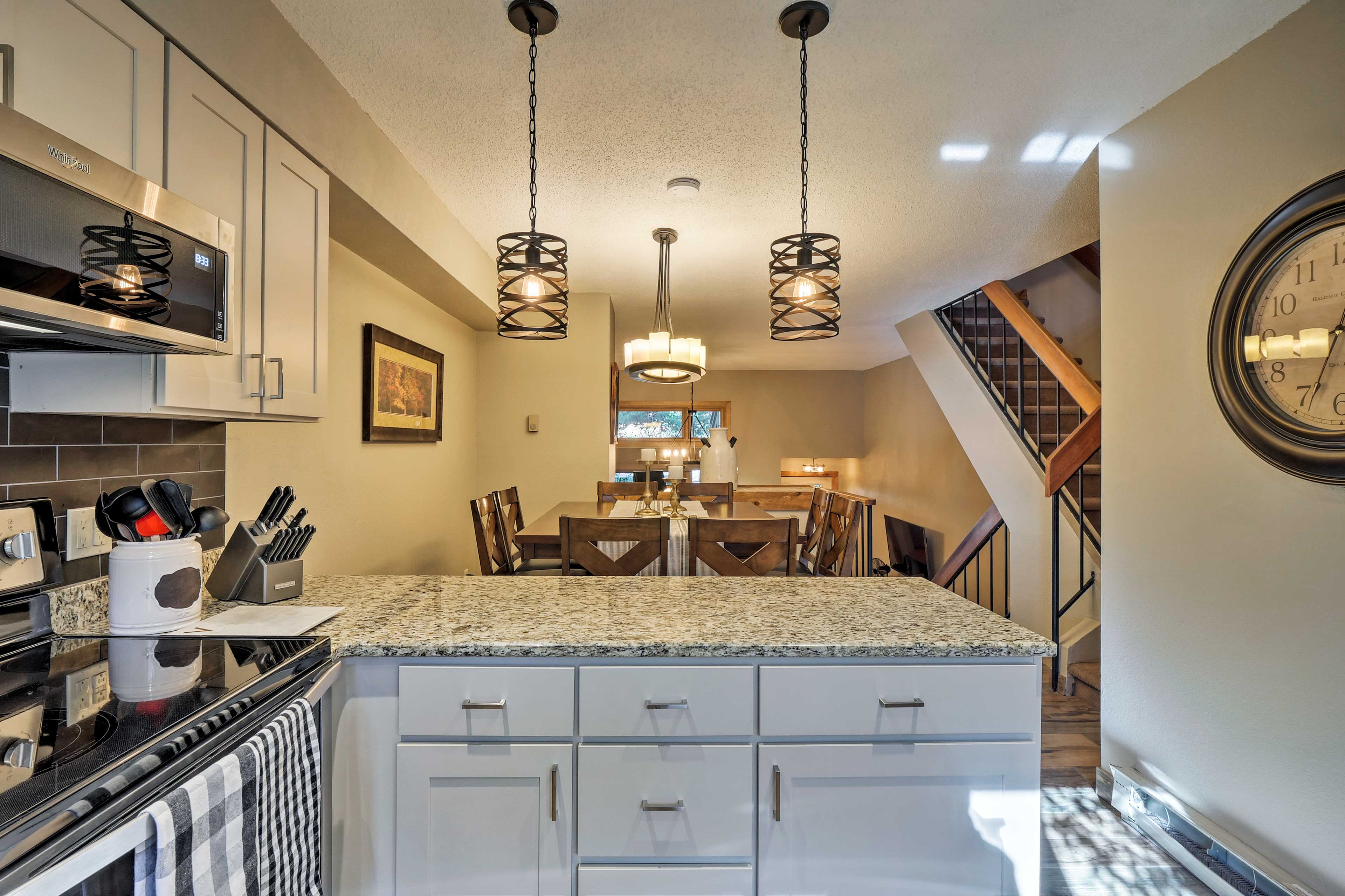 Keep the chef company at the long kitchen island while they prep dinner.