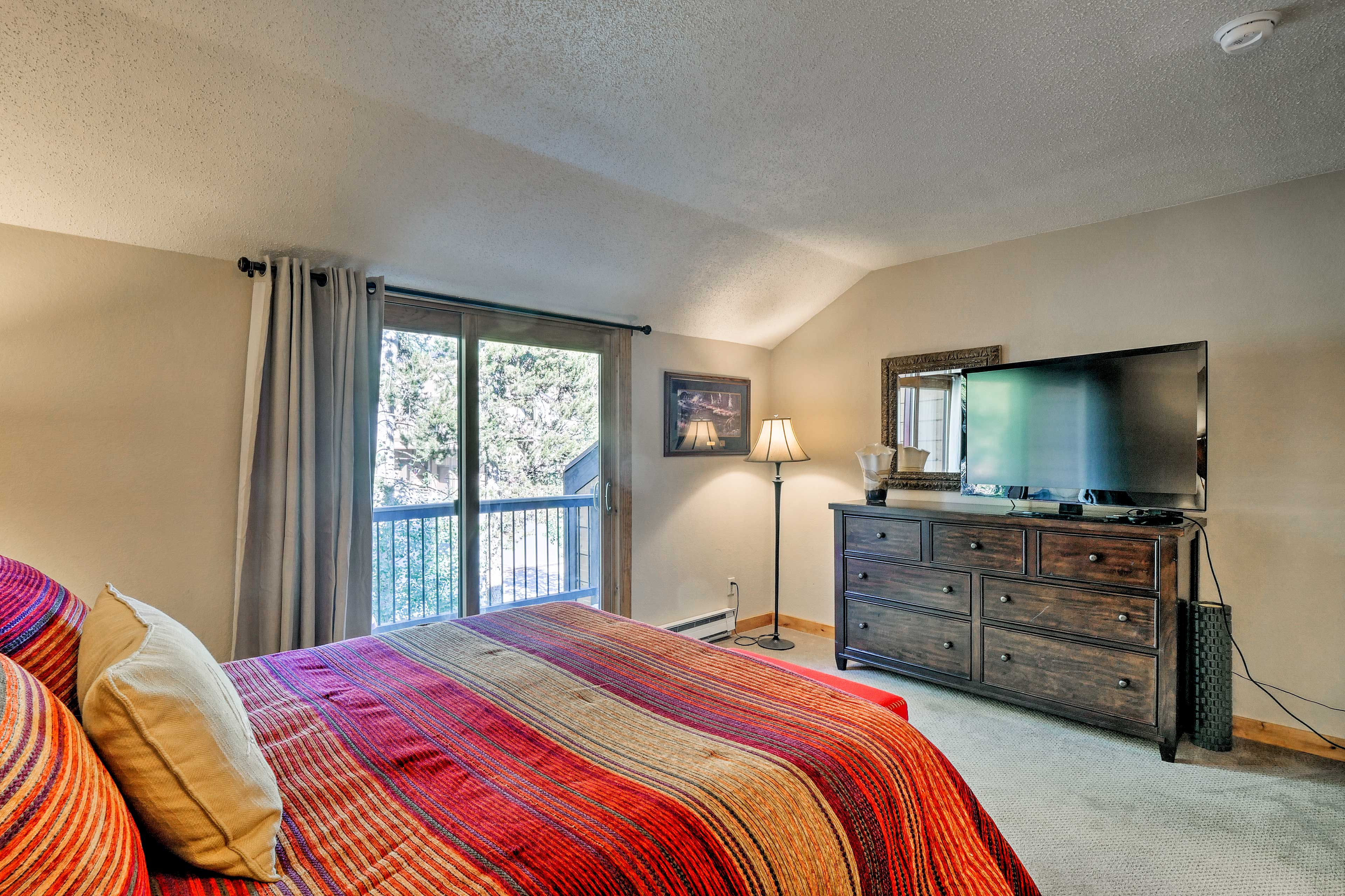 The master bedroom also features a flat-screen TV.