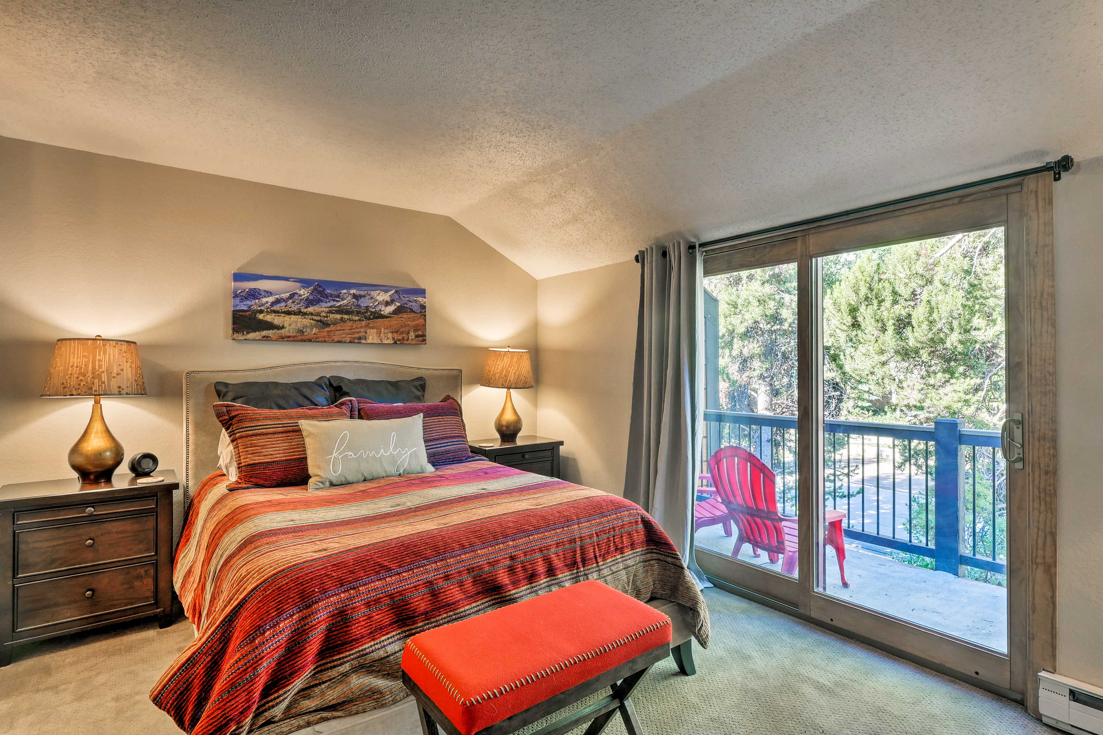 Sliding glass doors off the master bedroom lead to a private deck.