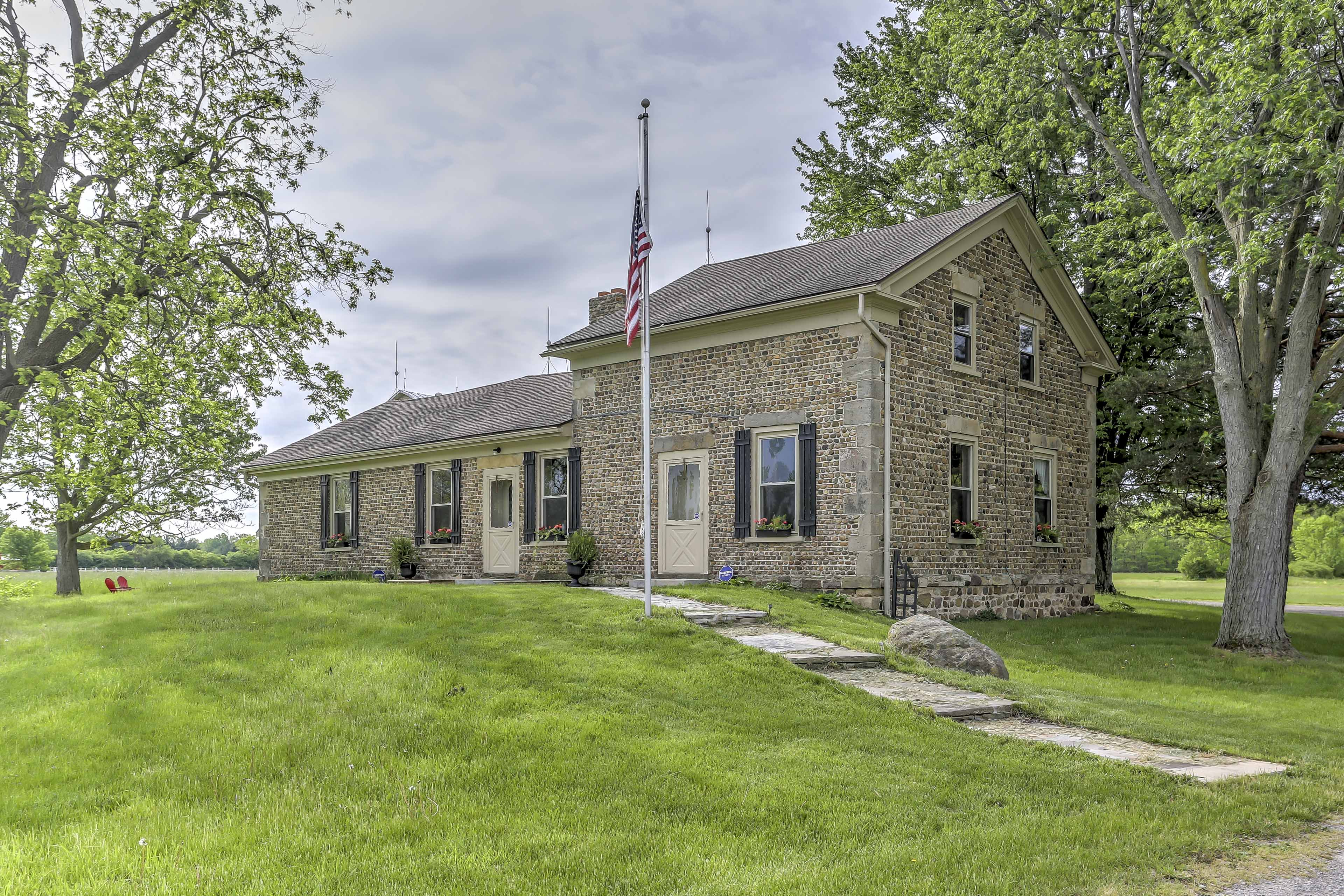 Escape to a historic farm setting at this Ottawa Lakes vacation rental house!
