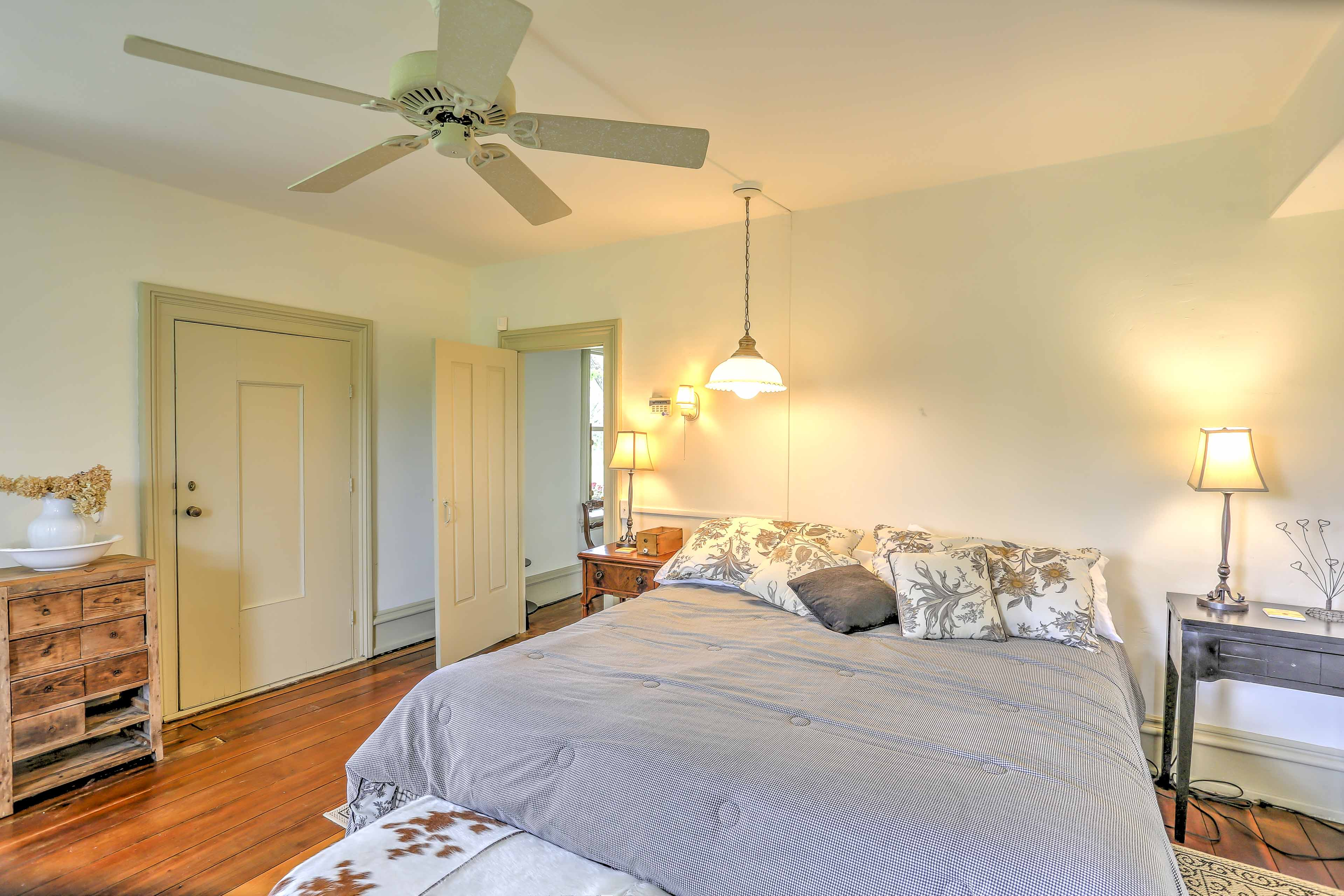 The master bedroom boasts a king-sized bed and a pristine en suite bathroom.