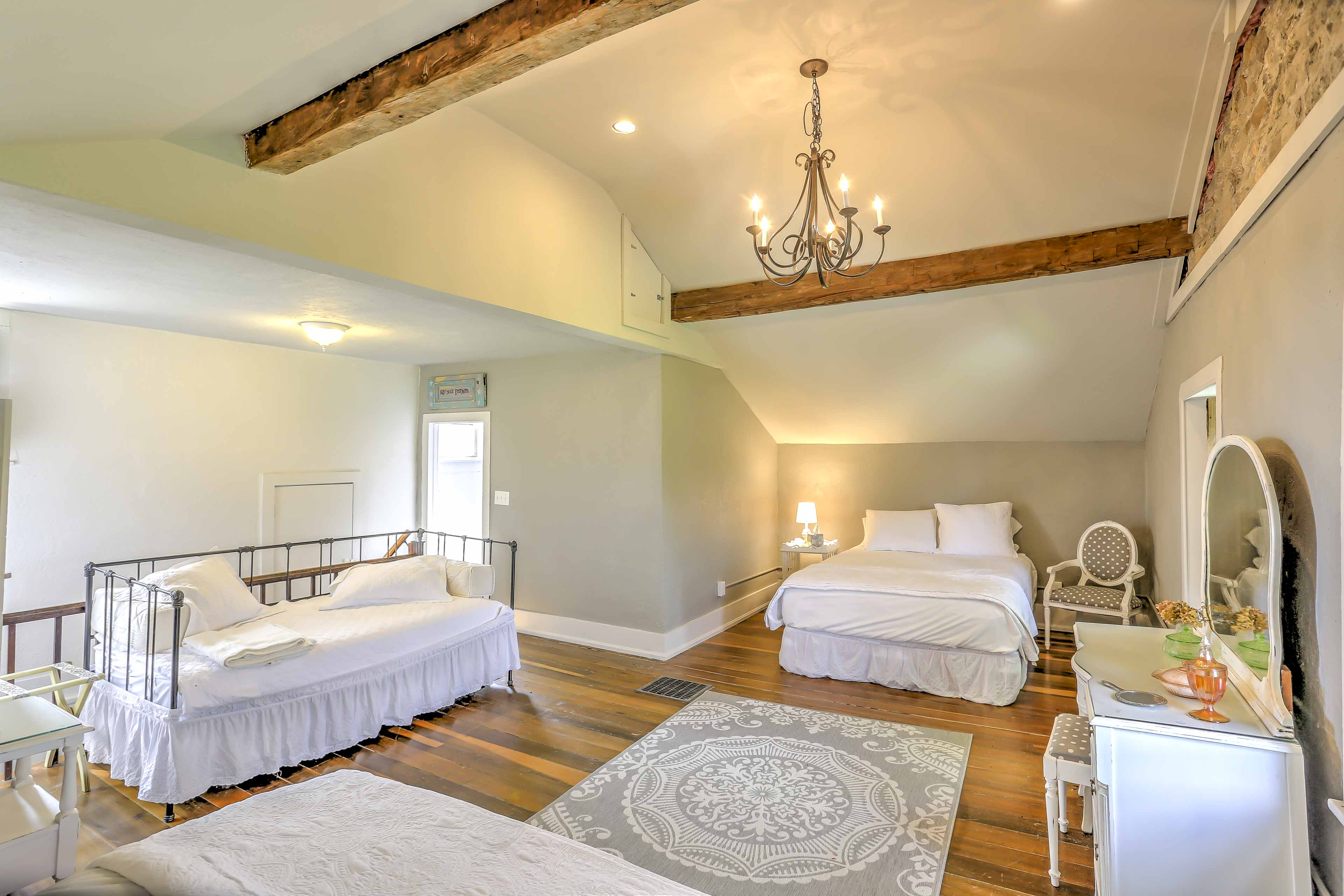 The dormitory bedroom features 2 queen beds and a twin trundle bed set.