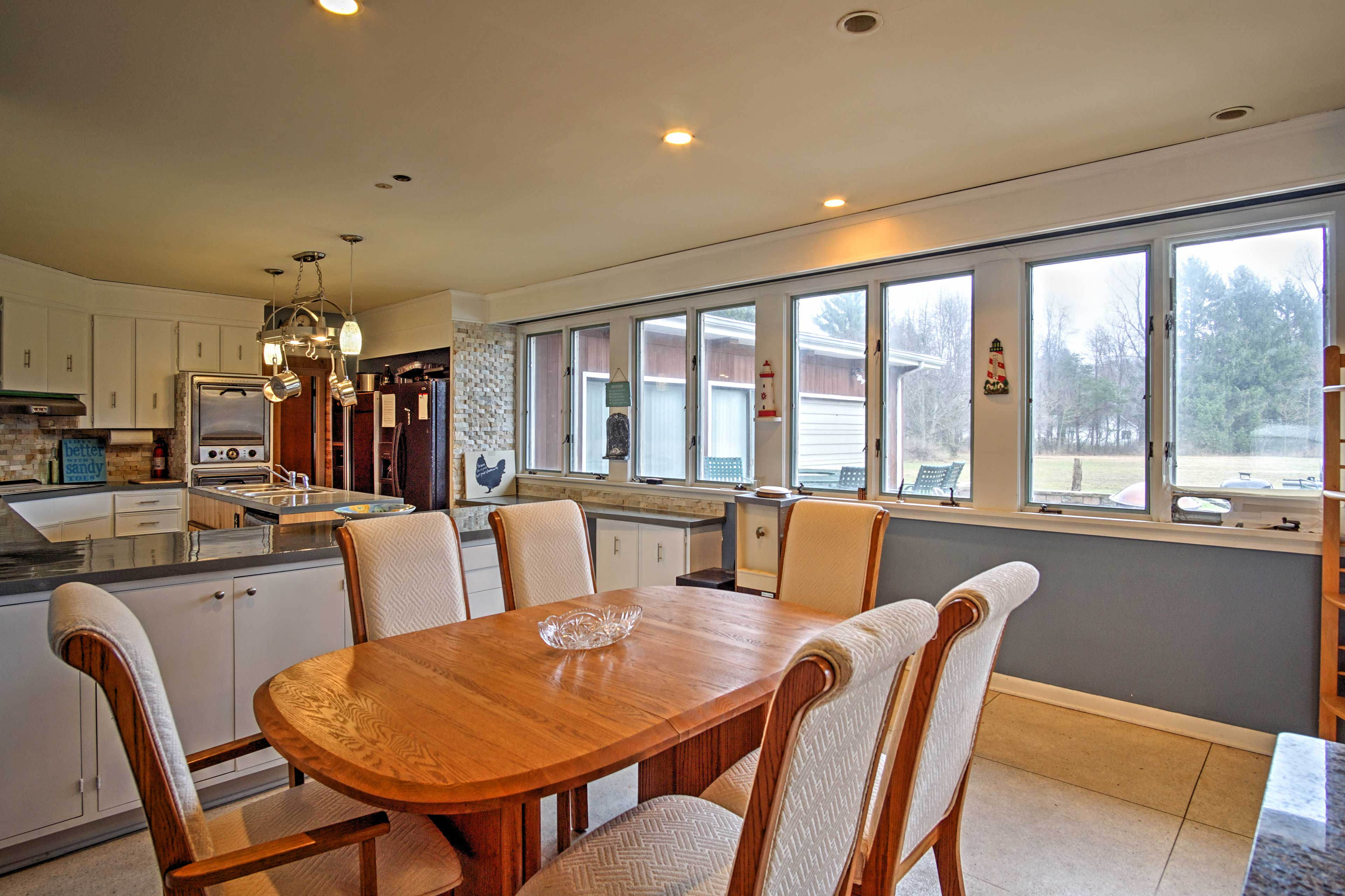 Gather around the dining table to enjoy your meals.
