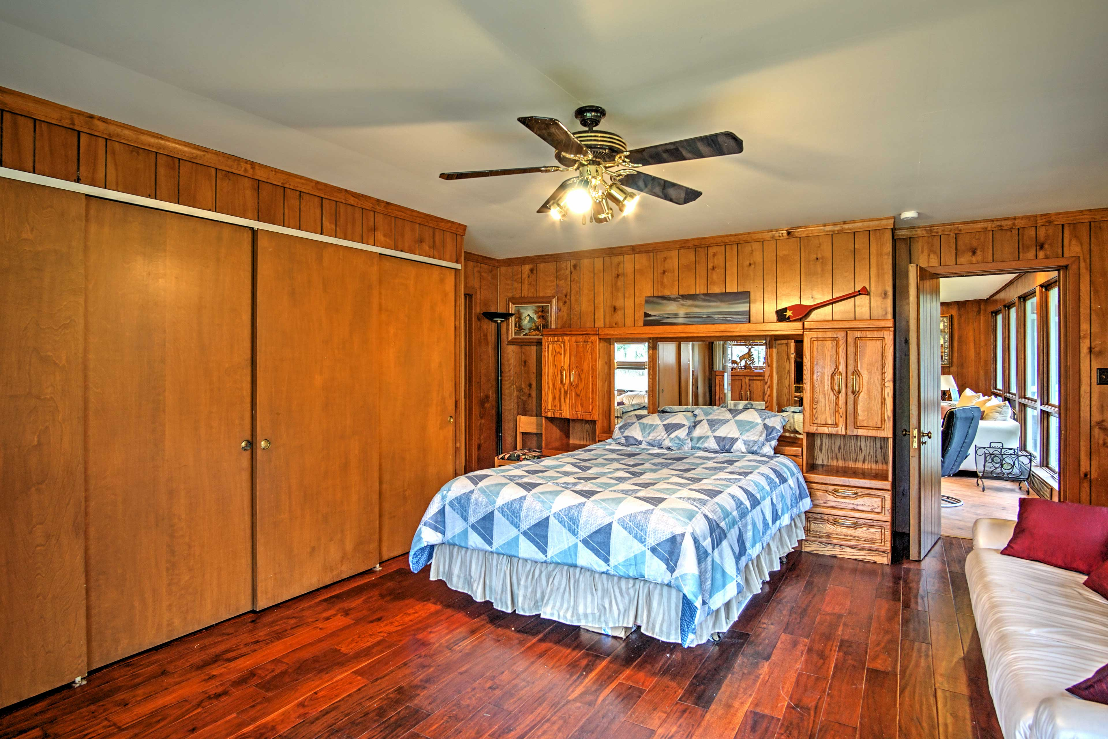 This wood-panneled bedroom offers rustic charm.