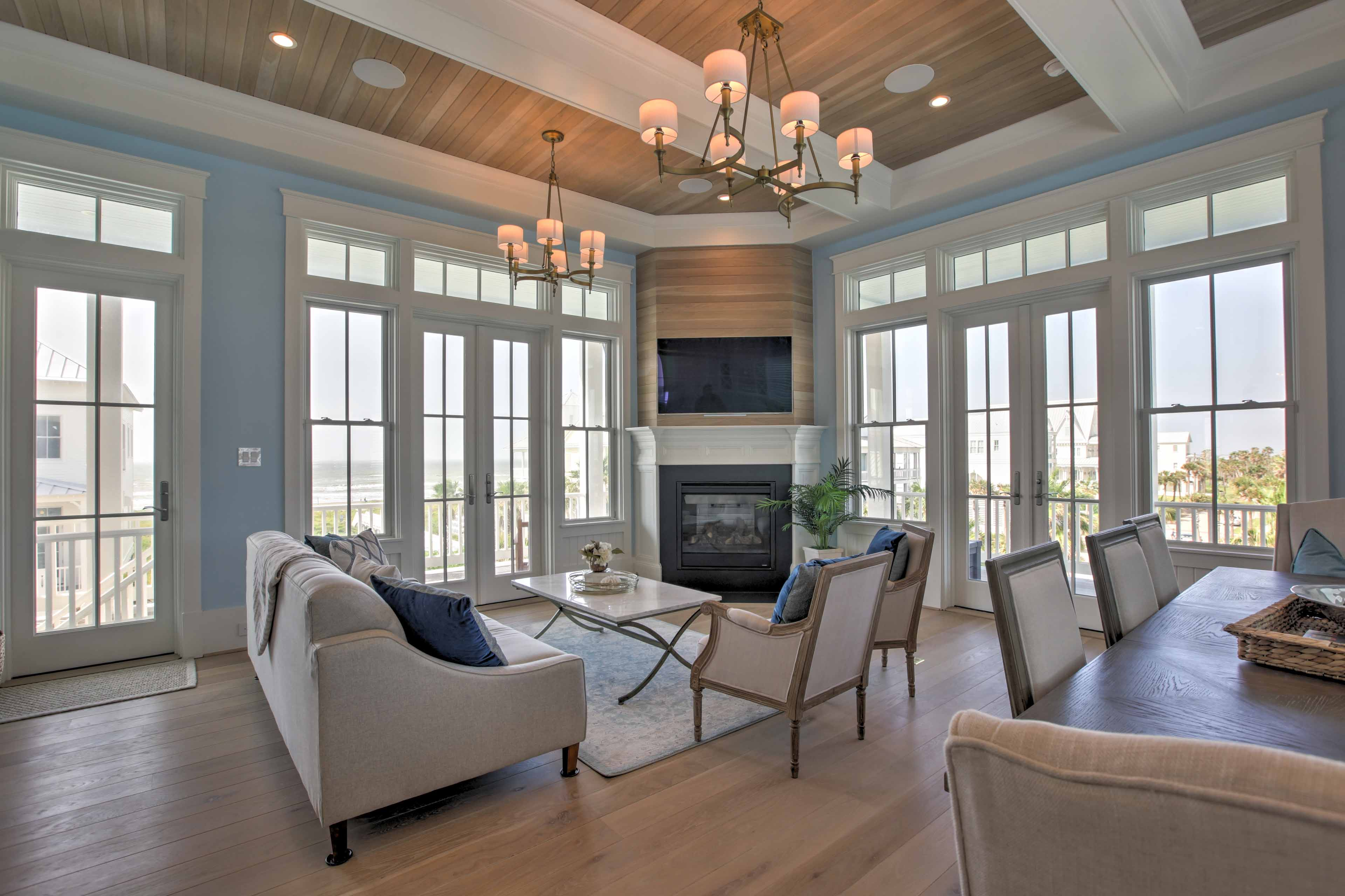 You'll find large windows and hardwood floors throughout the home.