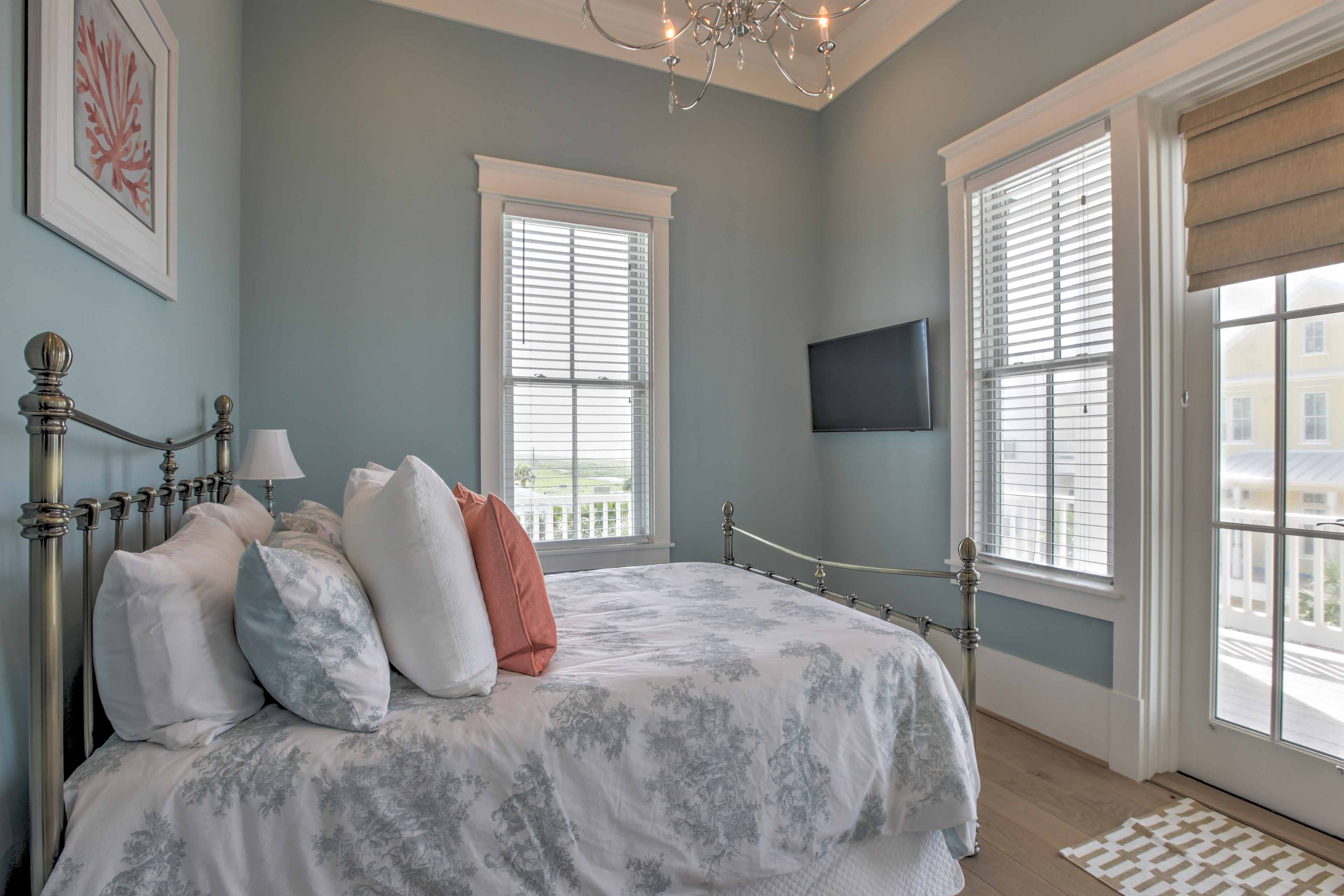 The second bedroom has a full-sized bed and private access to the balcony.