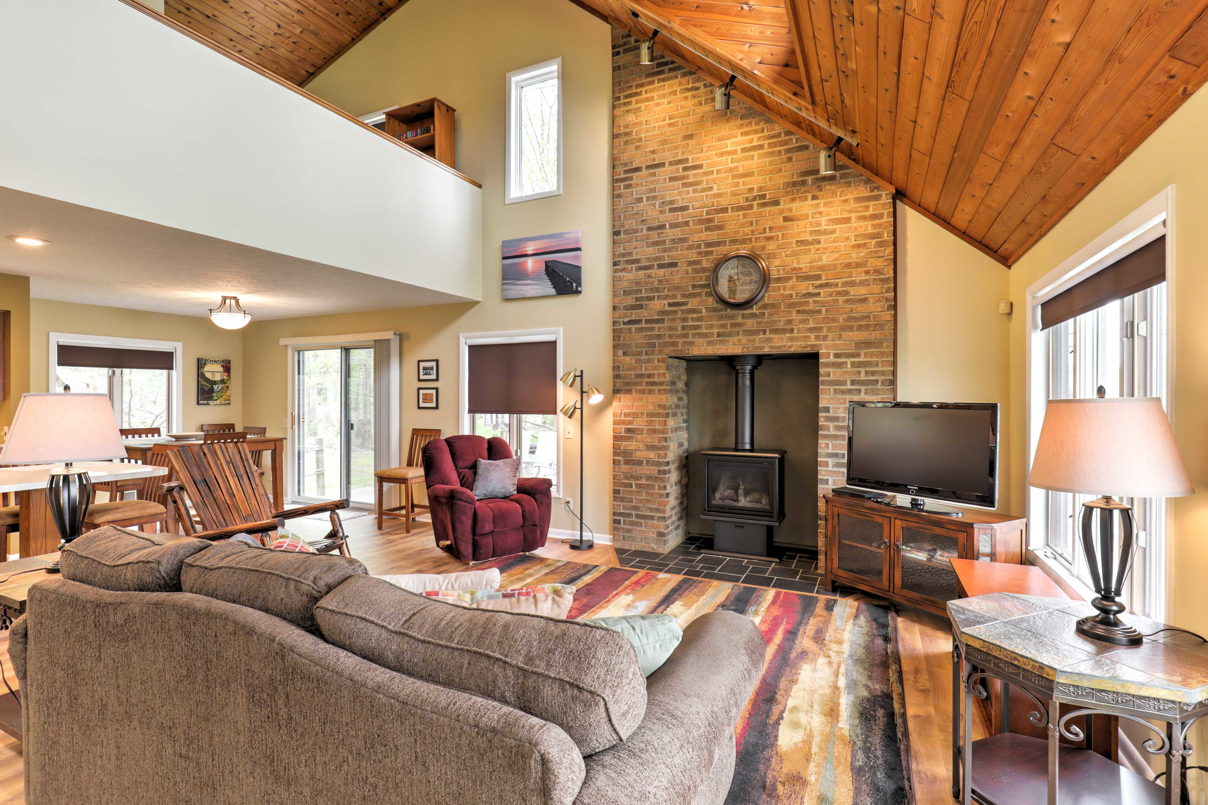 A cozy living room offers plush furniture and a large flat-screen TV.