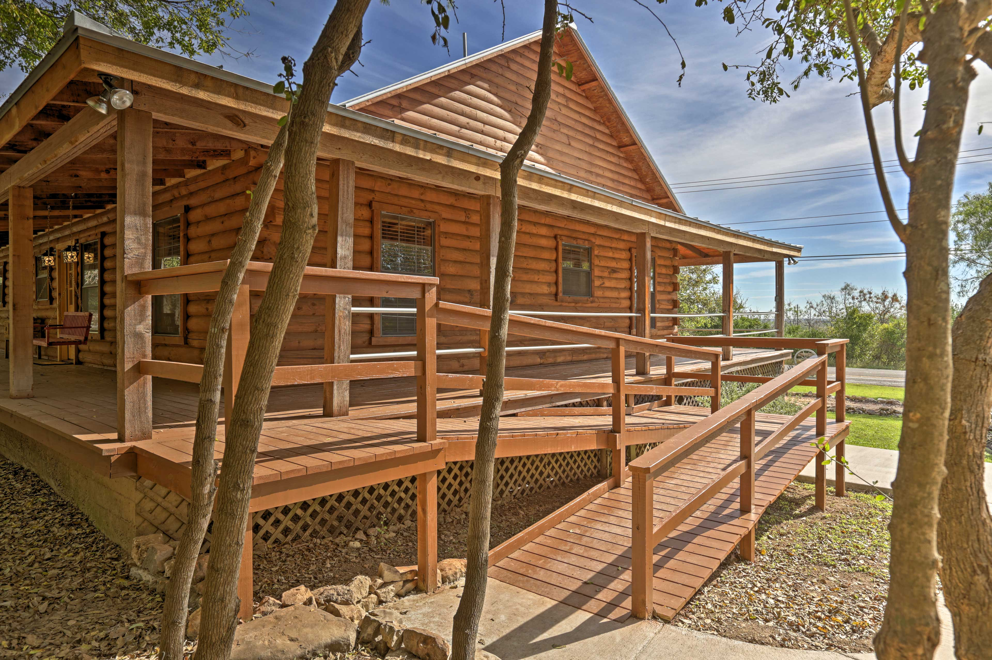 The home features a wraparound porch with views of Hill Country.