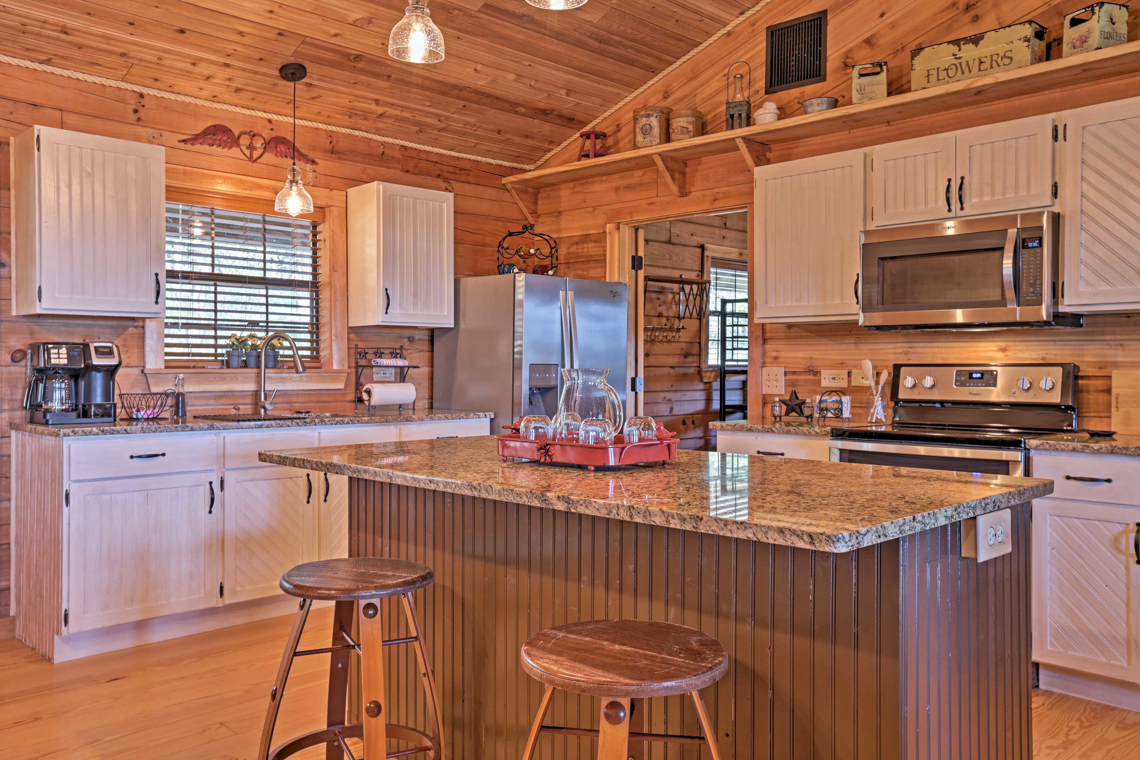 The kitchen is fully equipped with a large center island and seating for 2.