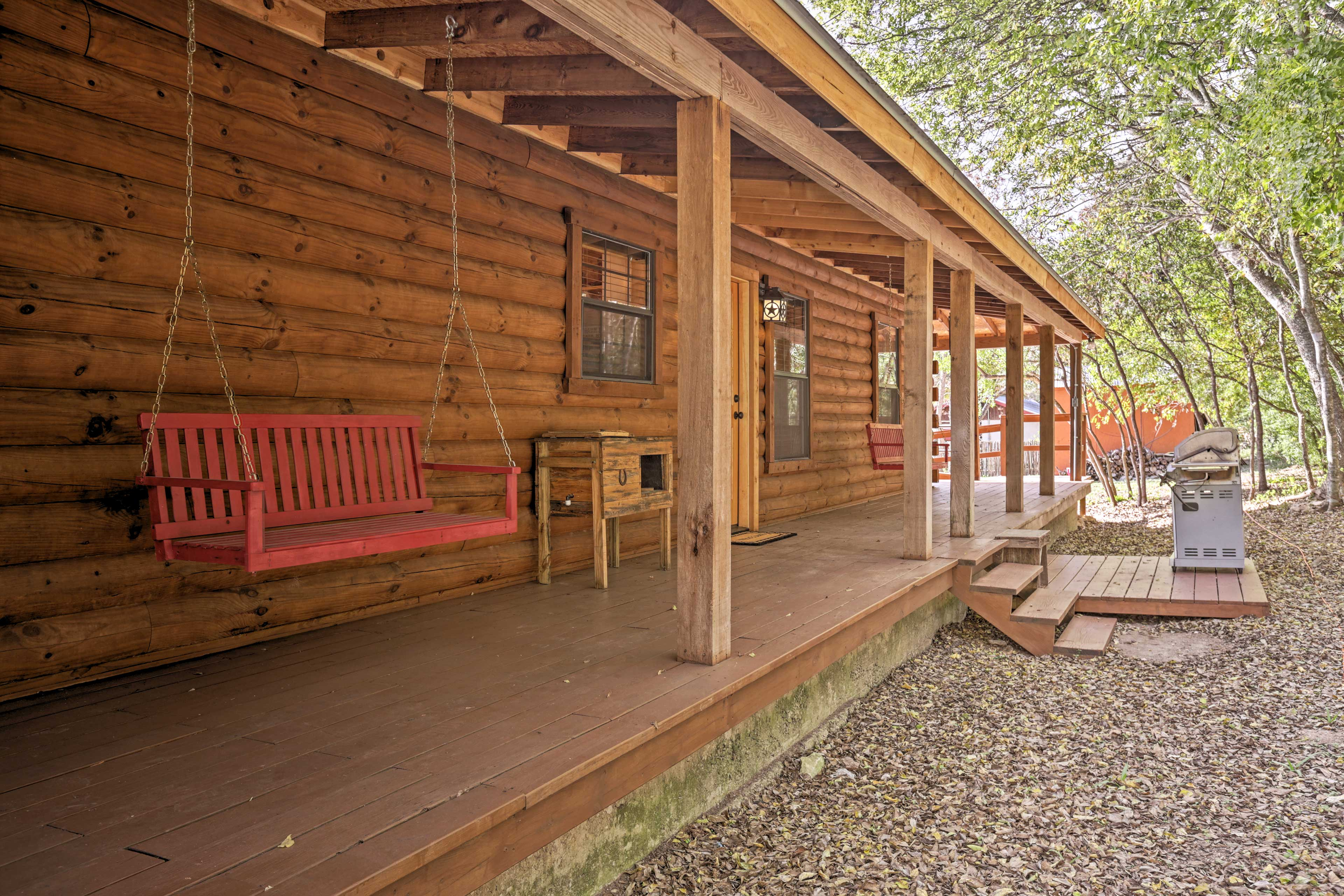 Relax on the covered porch to escape the heat.
