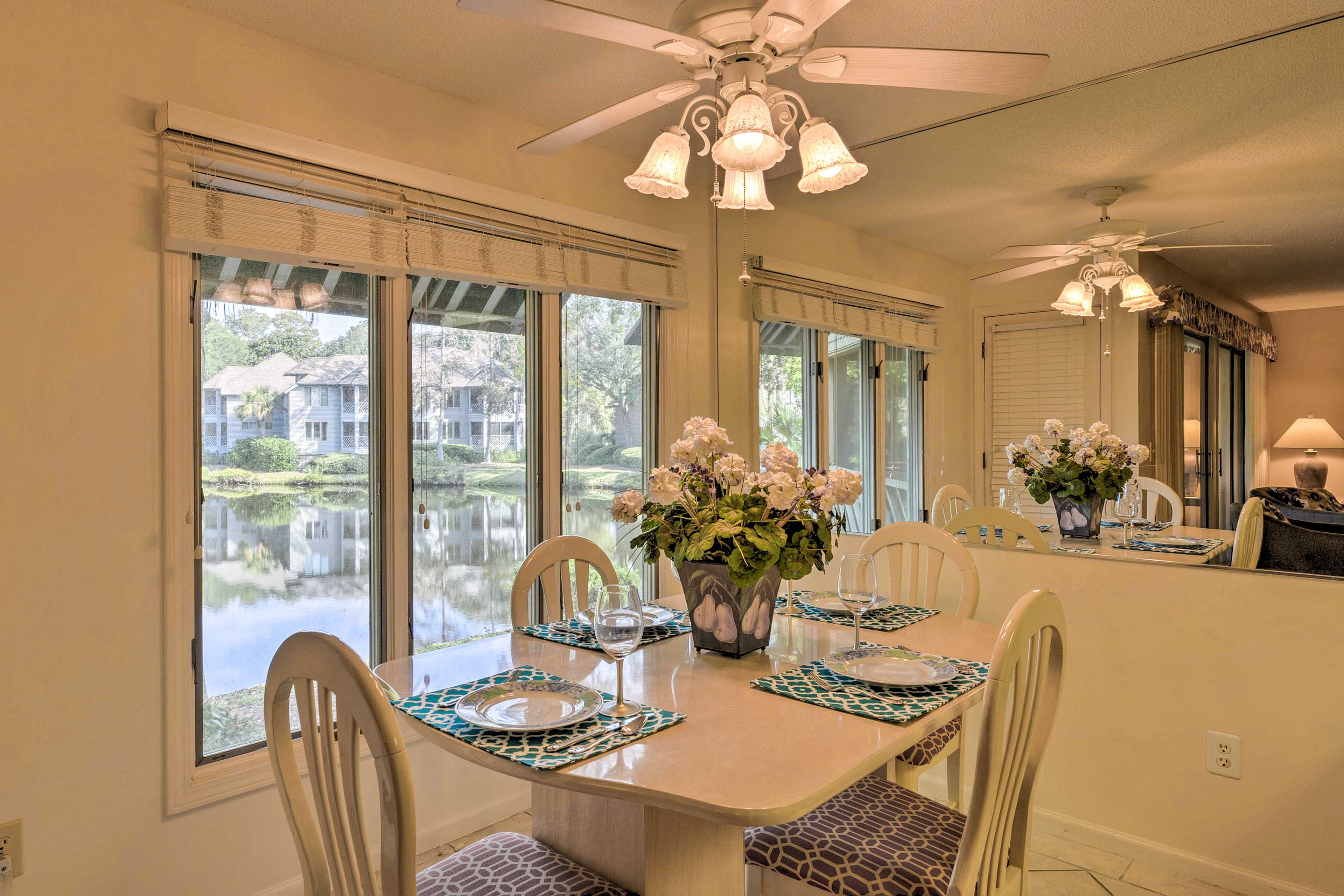 The 4-person table boasts waterfront views.