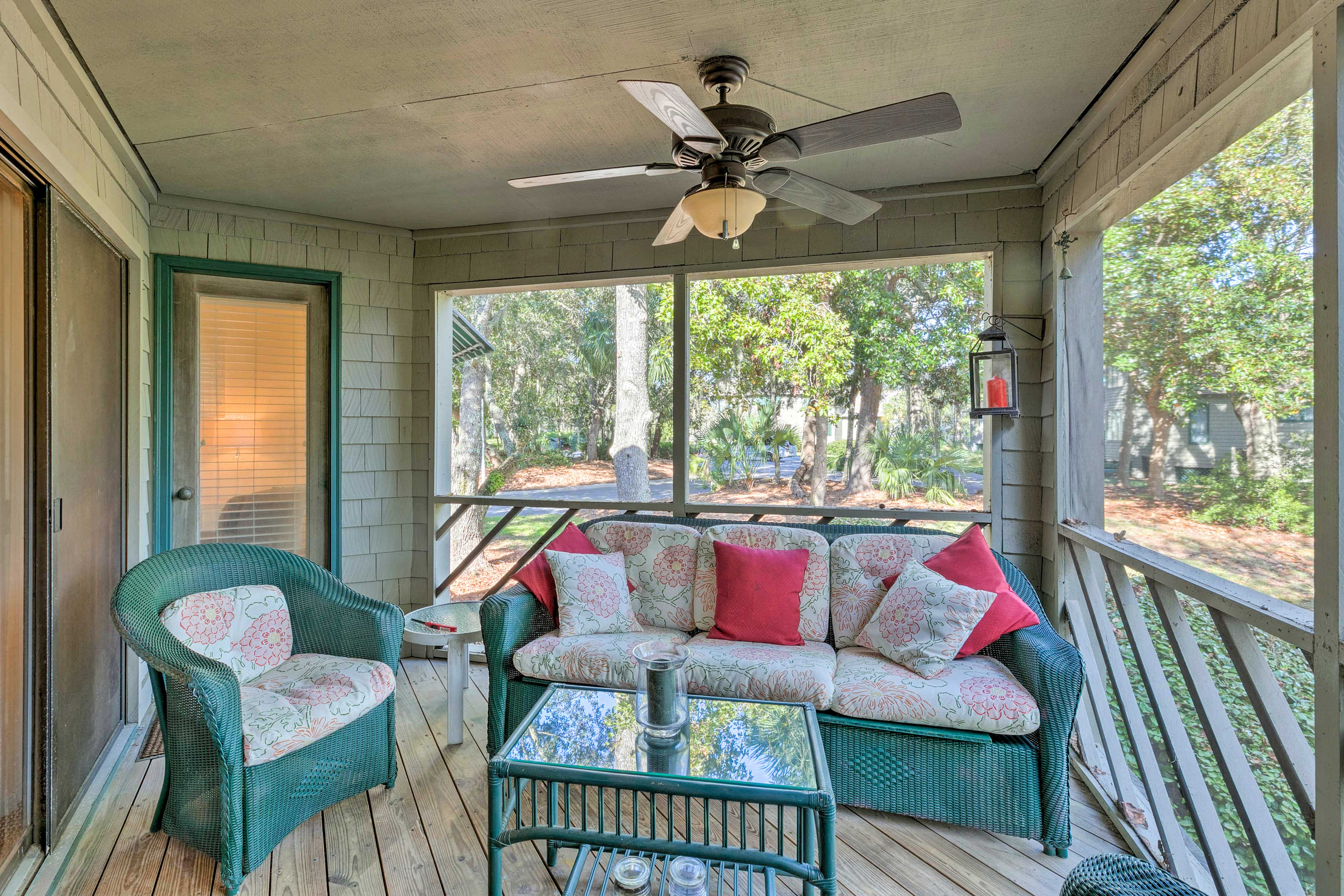 Relax outdoors on the screened-in porch.