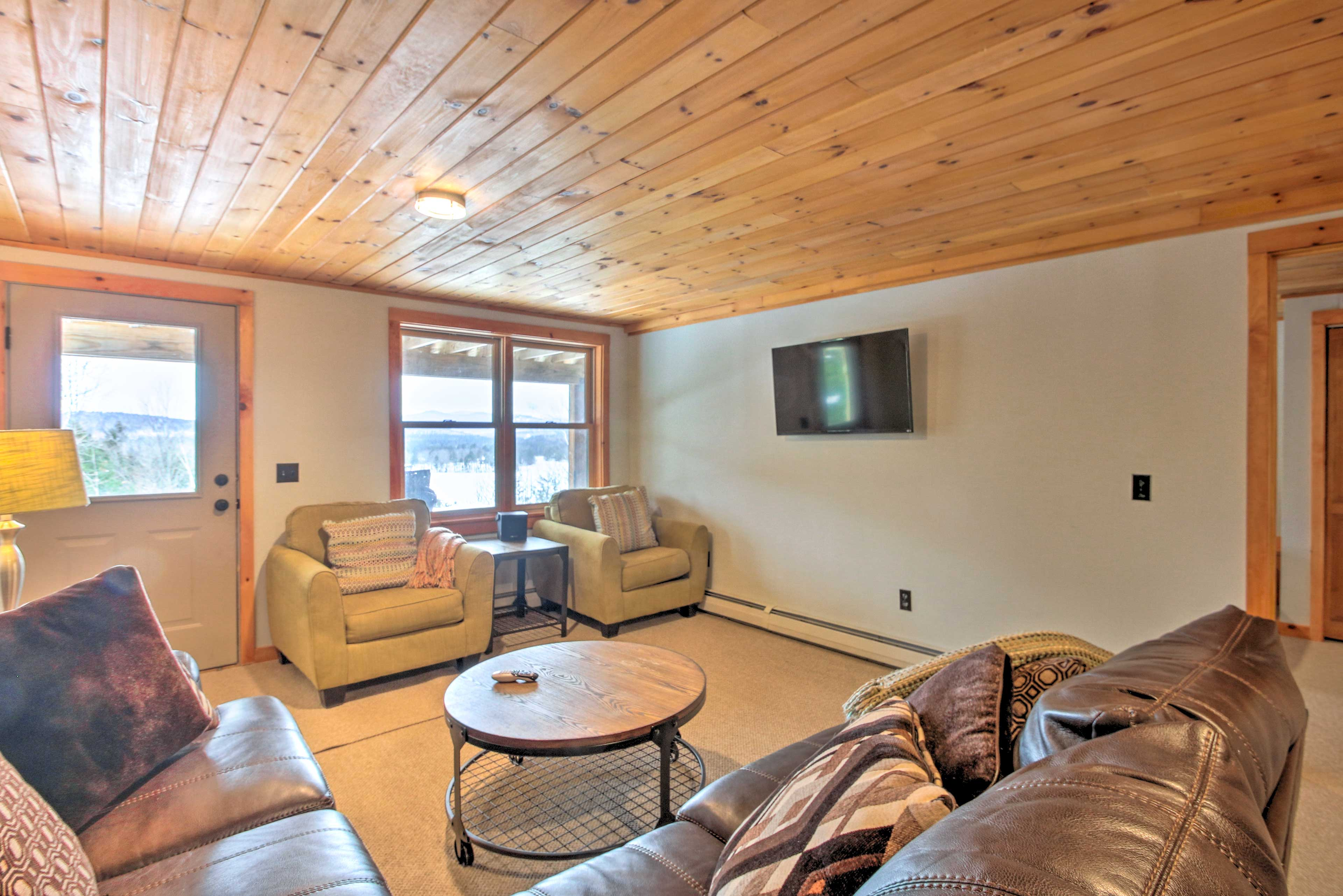 The basement has a flat-screen TV for all of your entertainment needs.