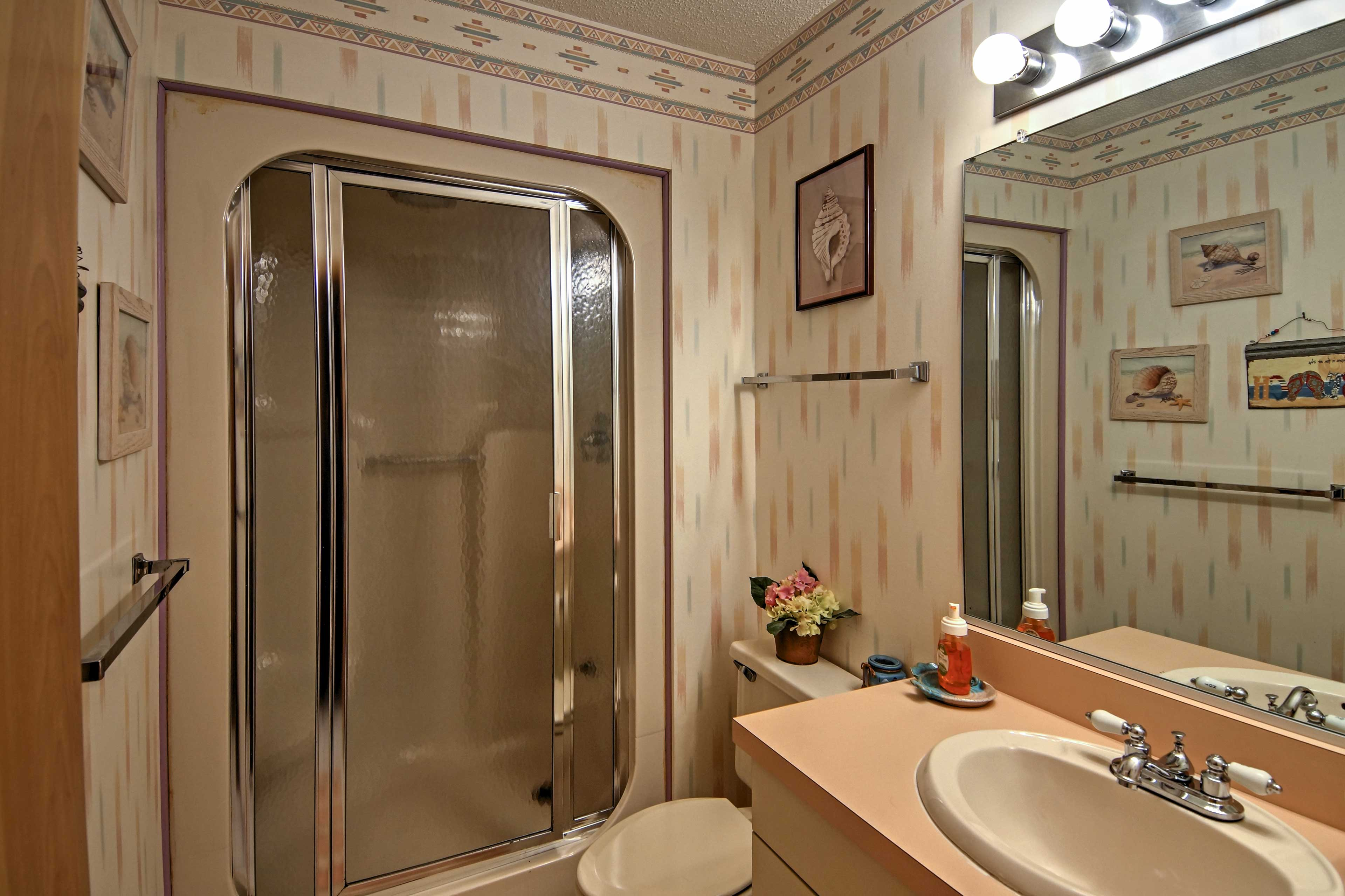 The guest bathroom offers a private sauna shower.