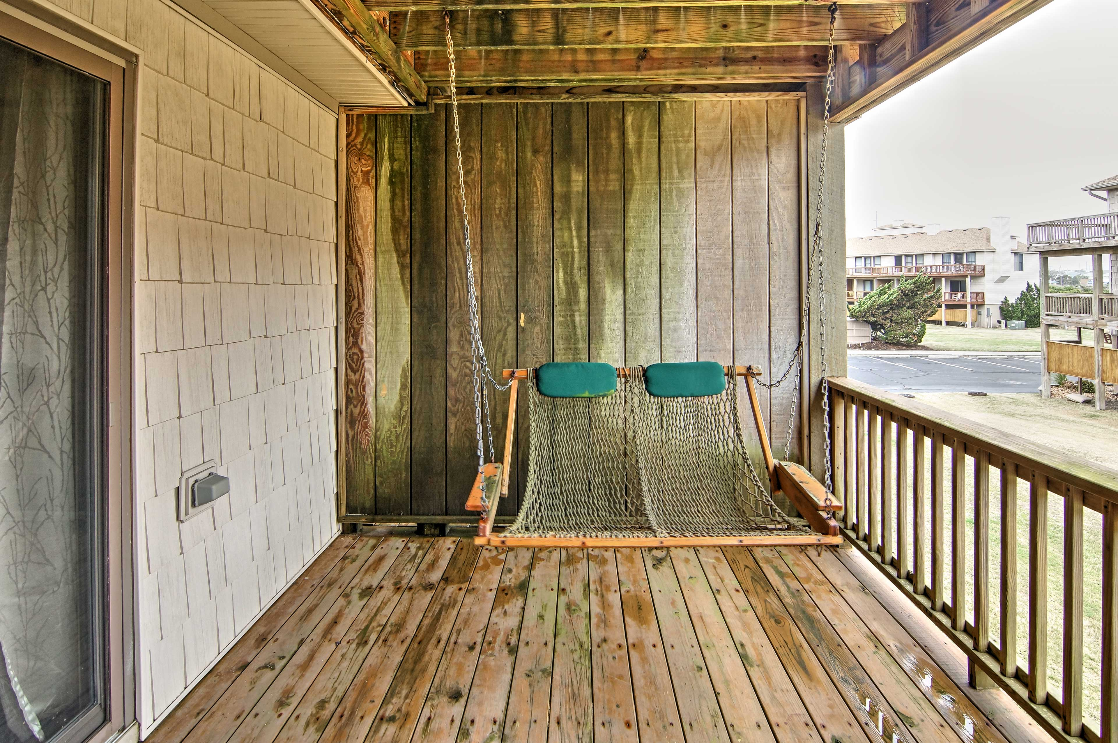 Lounge on the main-floor deck and sway on the hanging swing.