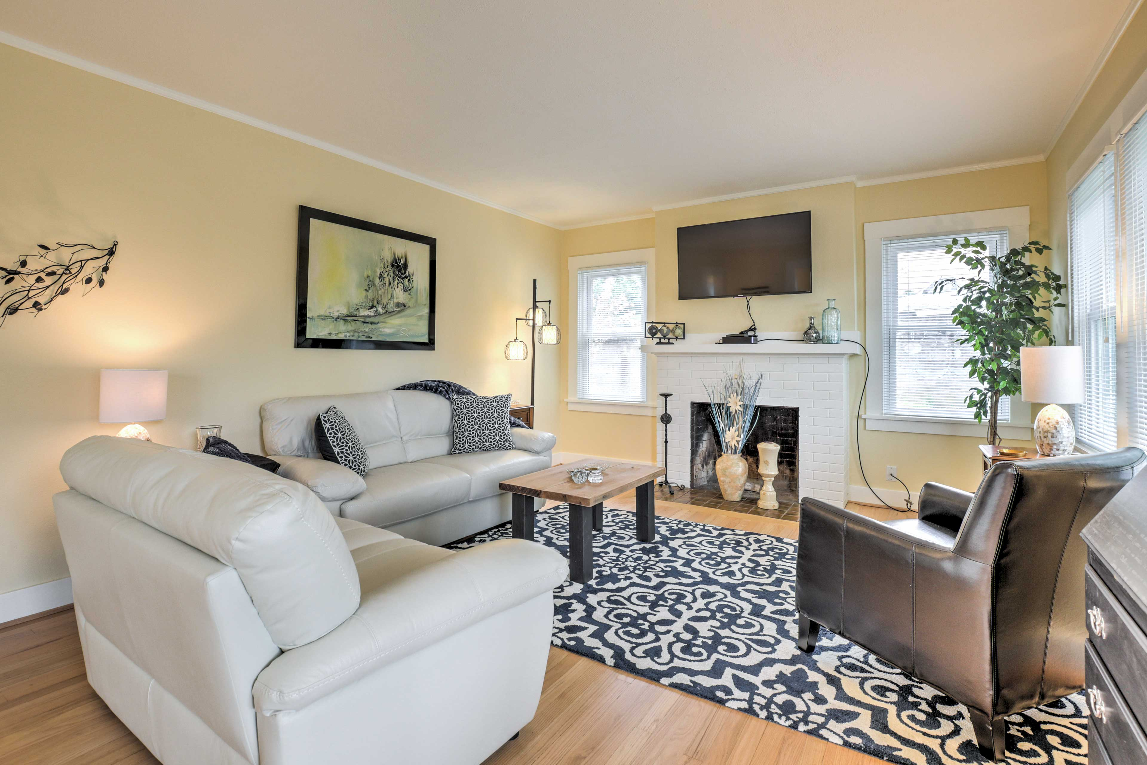 Relax in the living room, which features a flat-screen cable TV & gas fireplace.