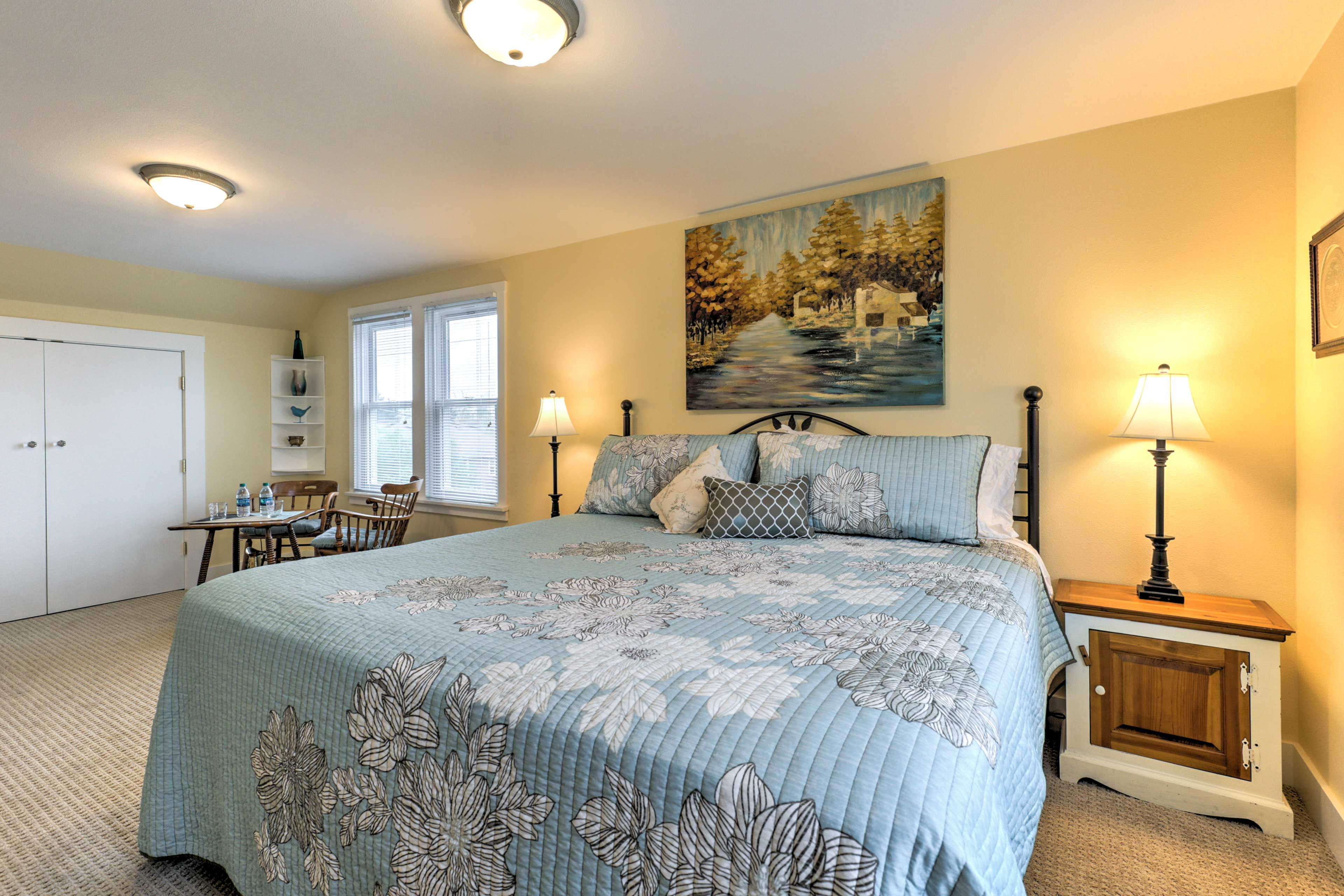 The spacious master bedroom is equipped with a plush king bed.