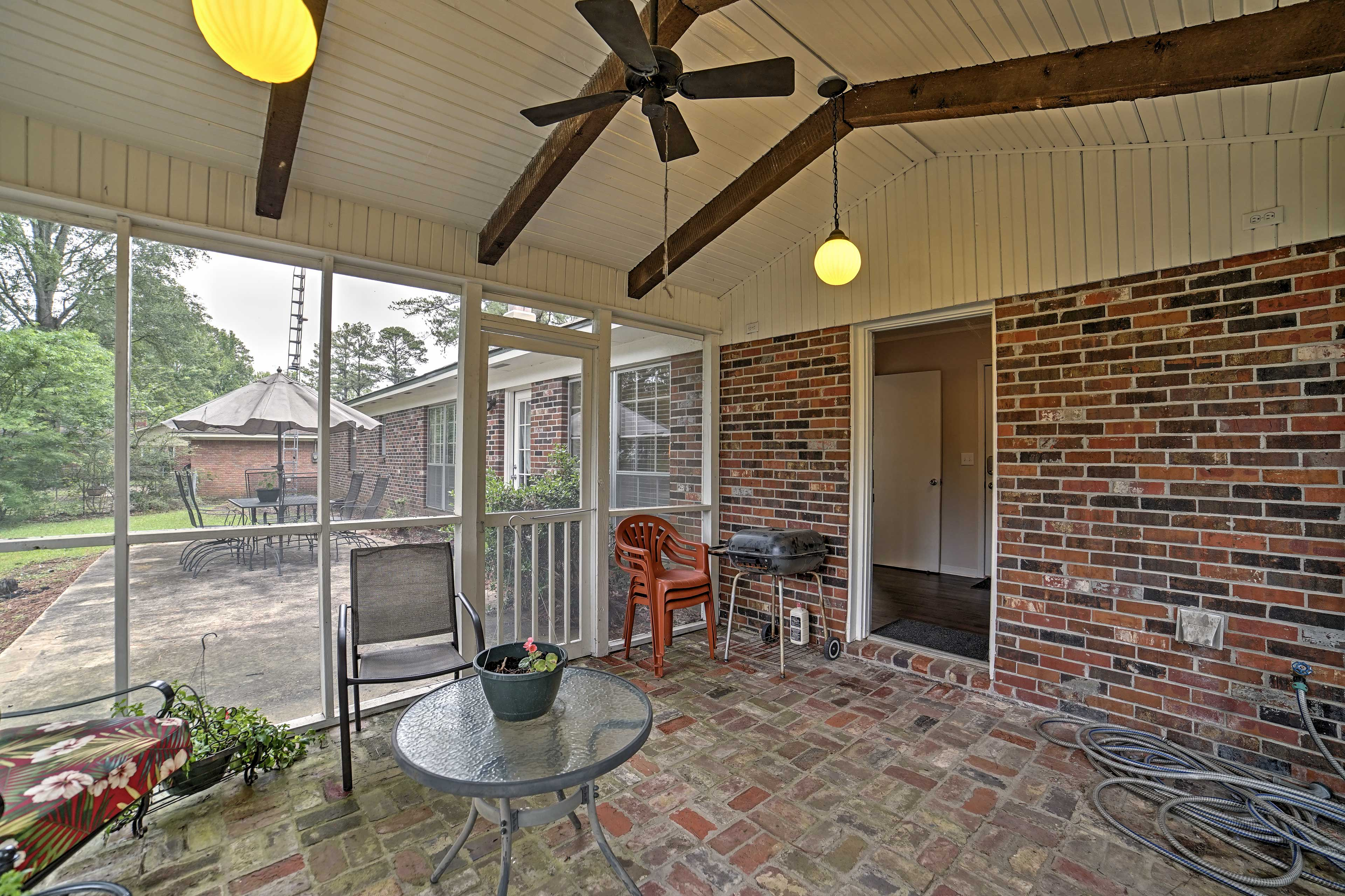 Enjoy fresh air from this screened-in porch.