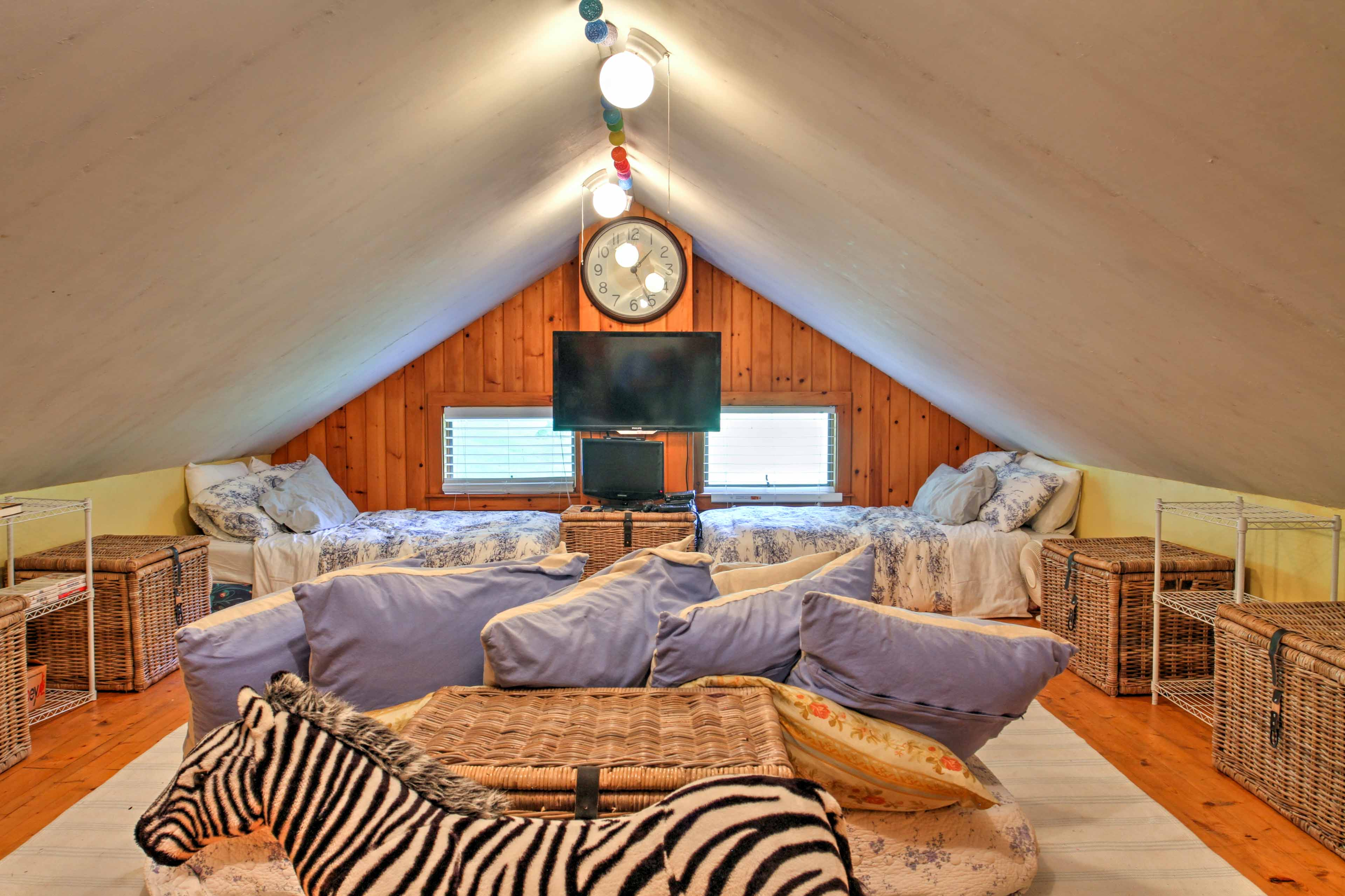 This bunk loft room contains 4 full-sized beds and 1 king-sized bed.