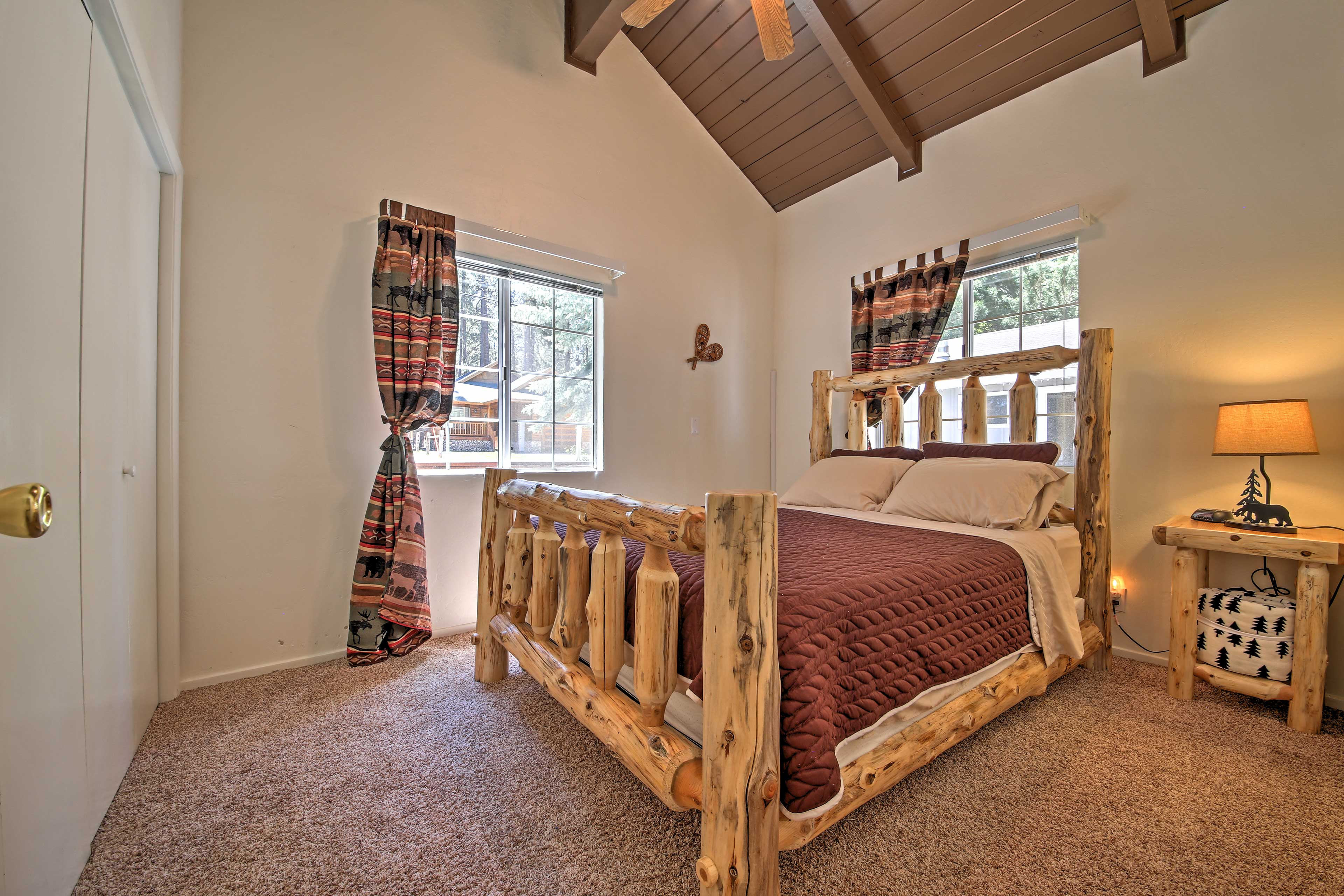 Cozy up in this queen-sized bed as you drift off into a deep sleep.