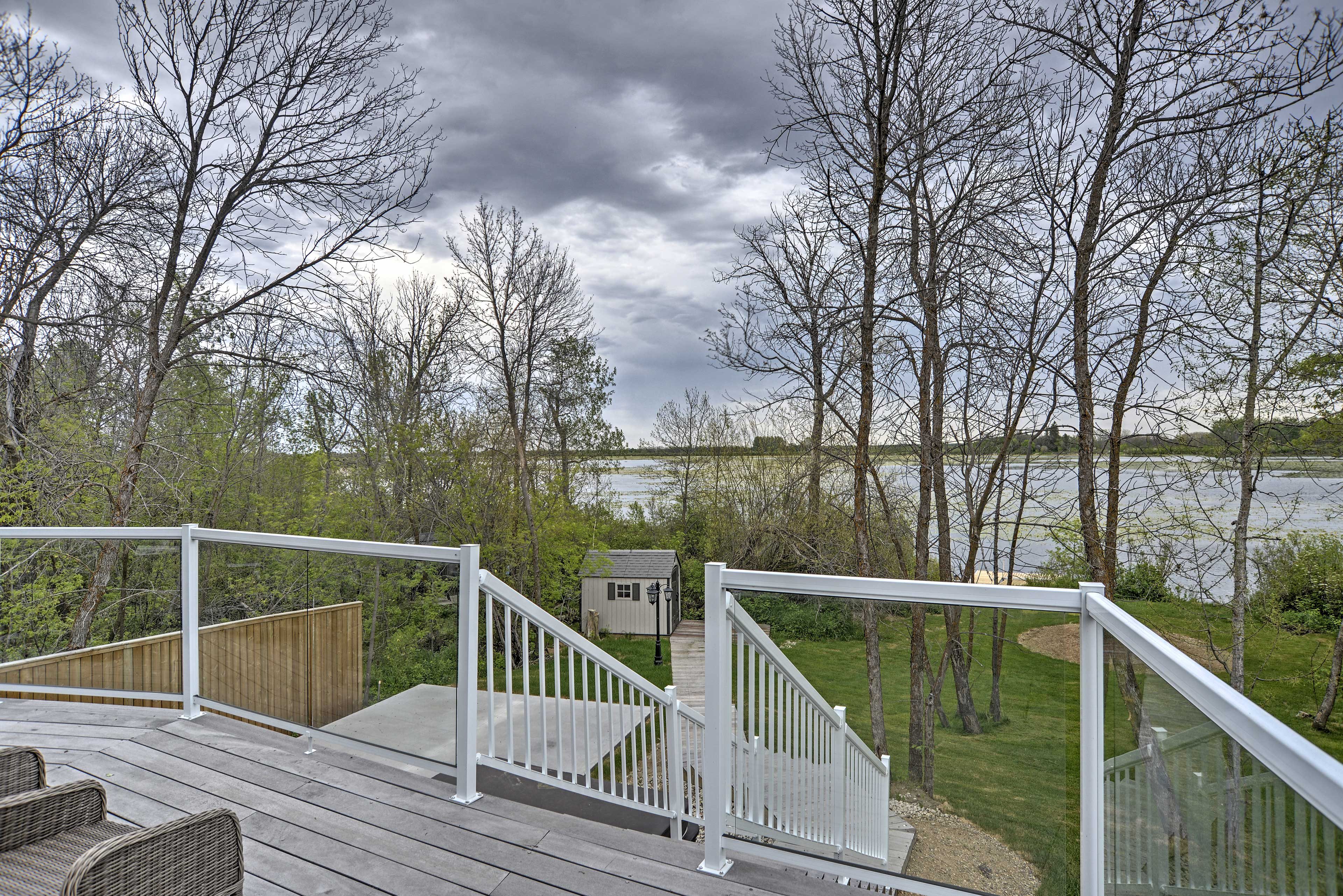 The spacious deck looks out over the lake.