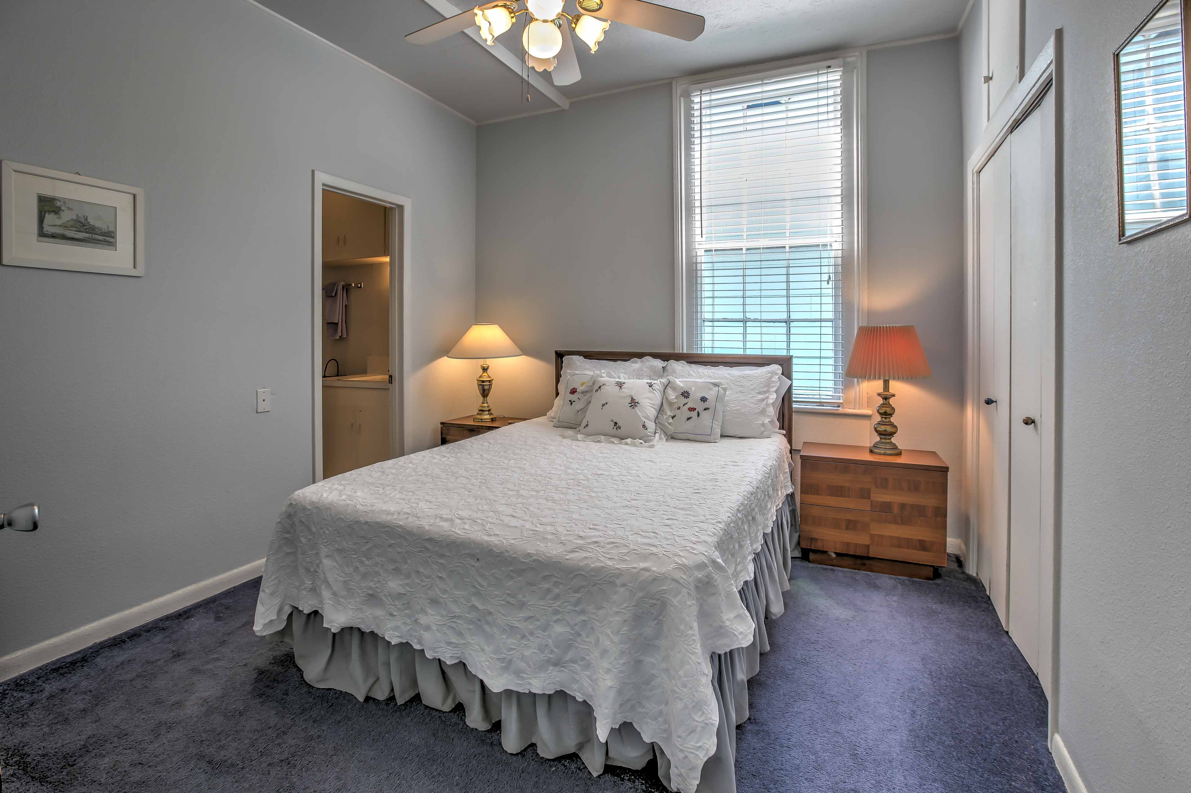 The master bedroom and front bedroom have queen beds and private bathrooms.