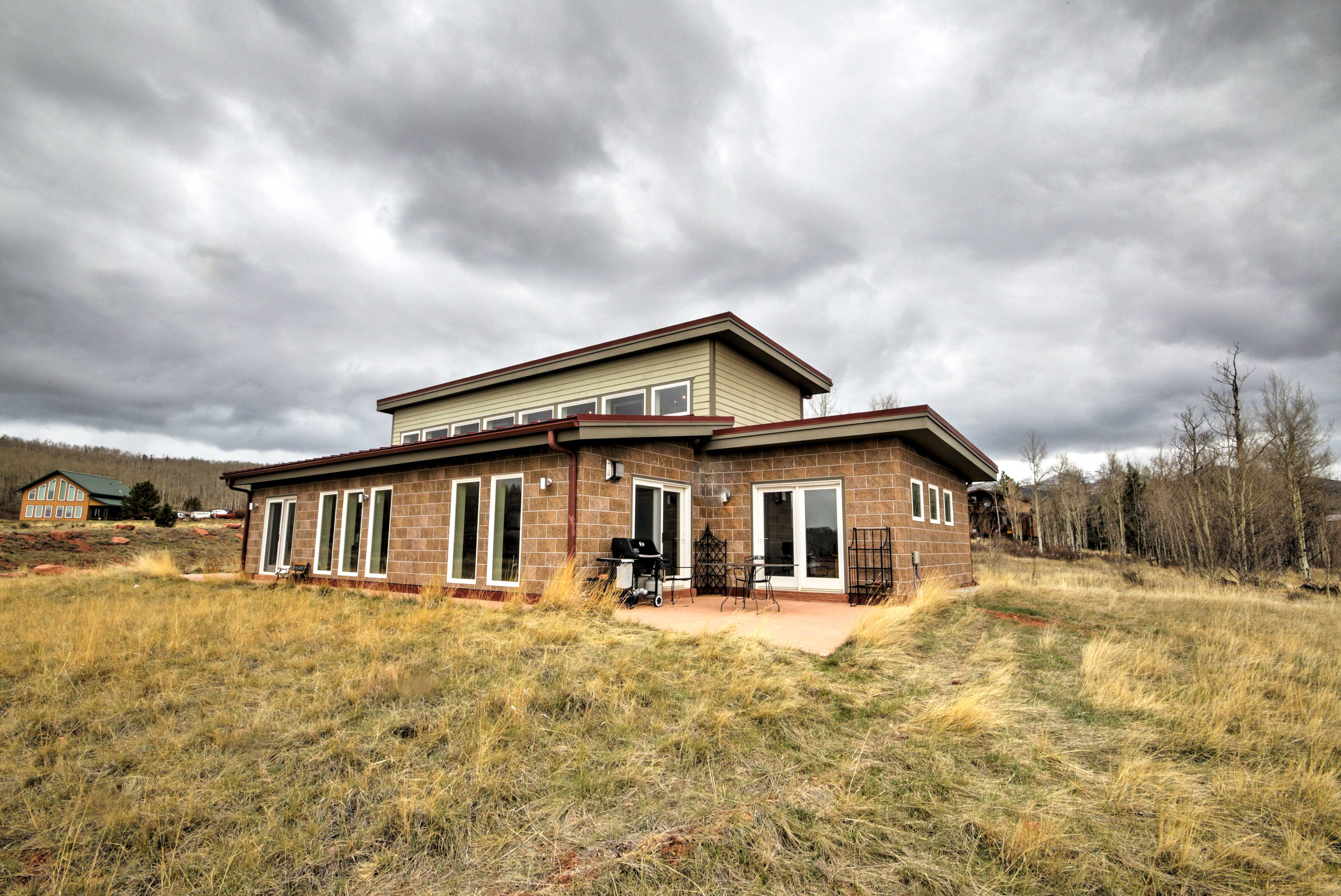 Guests will comfortably sleep in this eco-friendly home which sits on 6-acres.