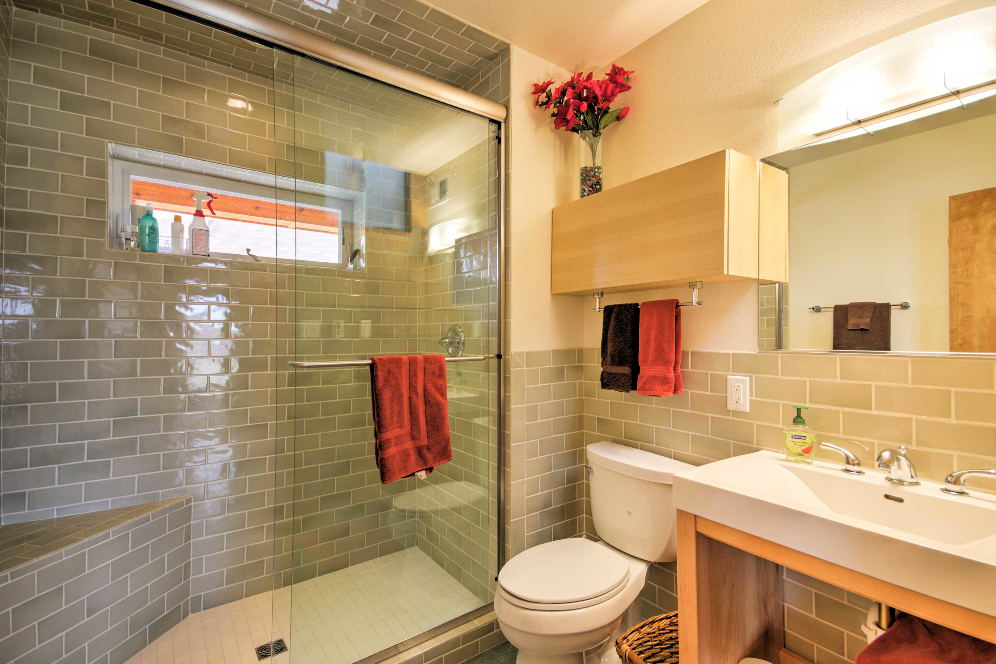 Both the master bathroom and guest bathroom feature brand new walk-in shower.