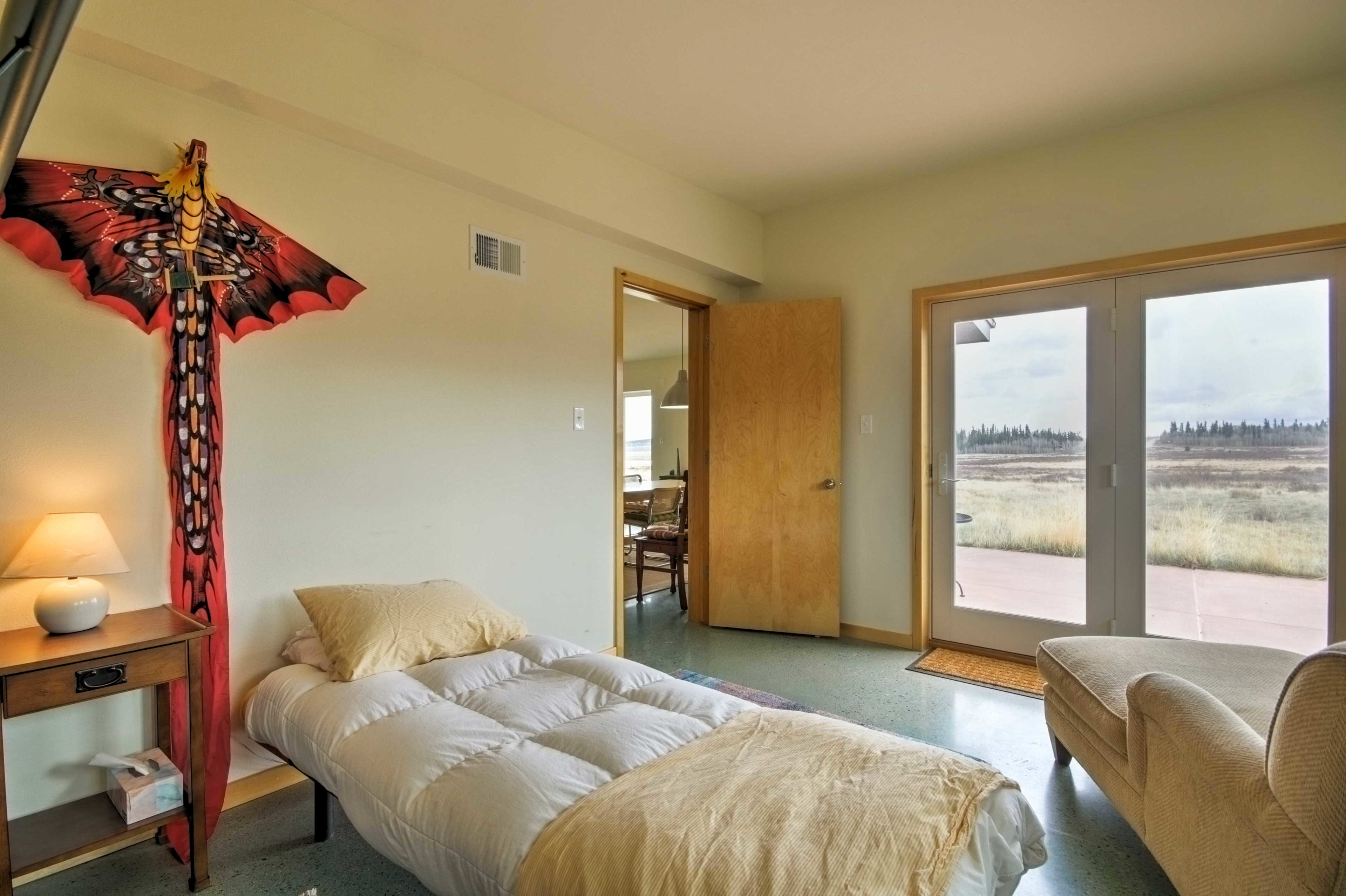 This sun-filled bedroom opens directly onto the patio.