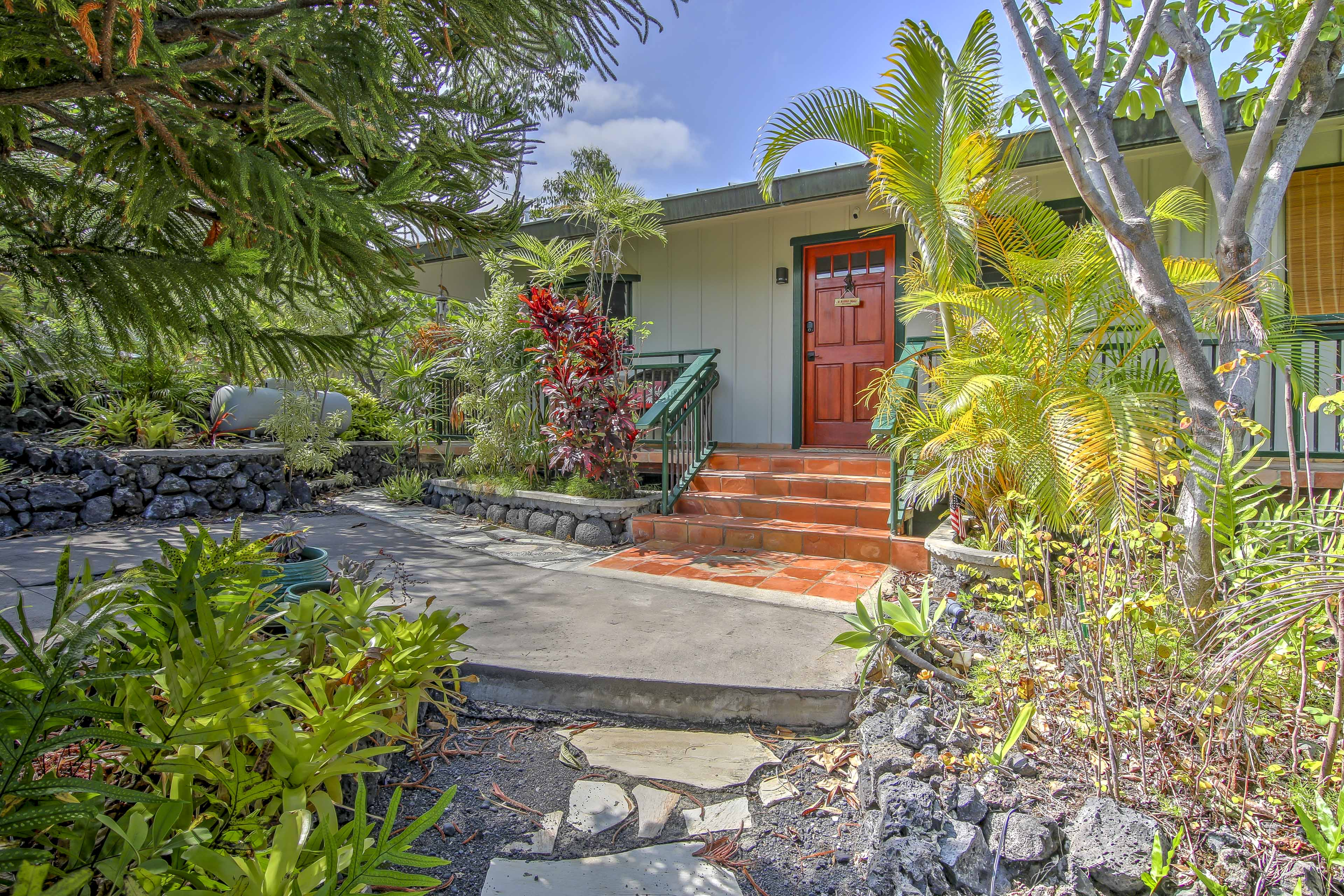 This spectacular property boasts a wrap-around lanai with tranquil views of the ocean.