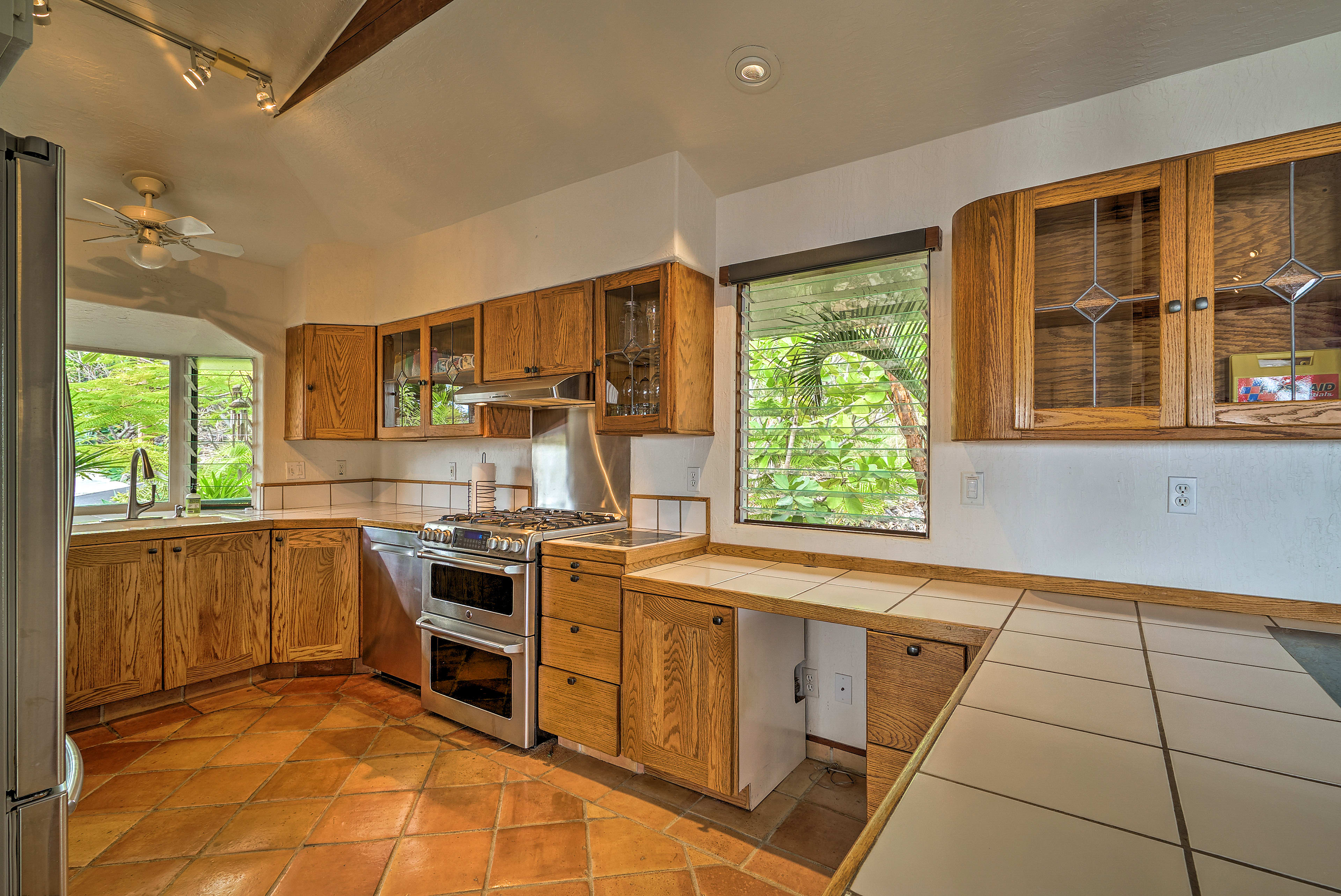 With natural wood elements, you'll love the fully equipped kitchen.