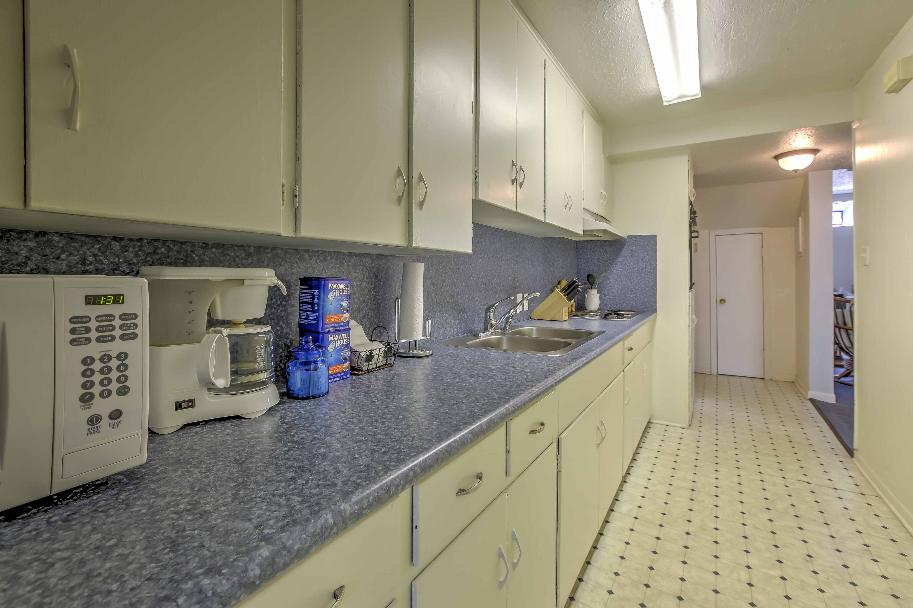 The kitchen has plenty of counter space to prepare any recipe.