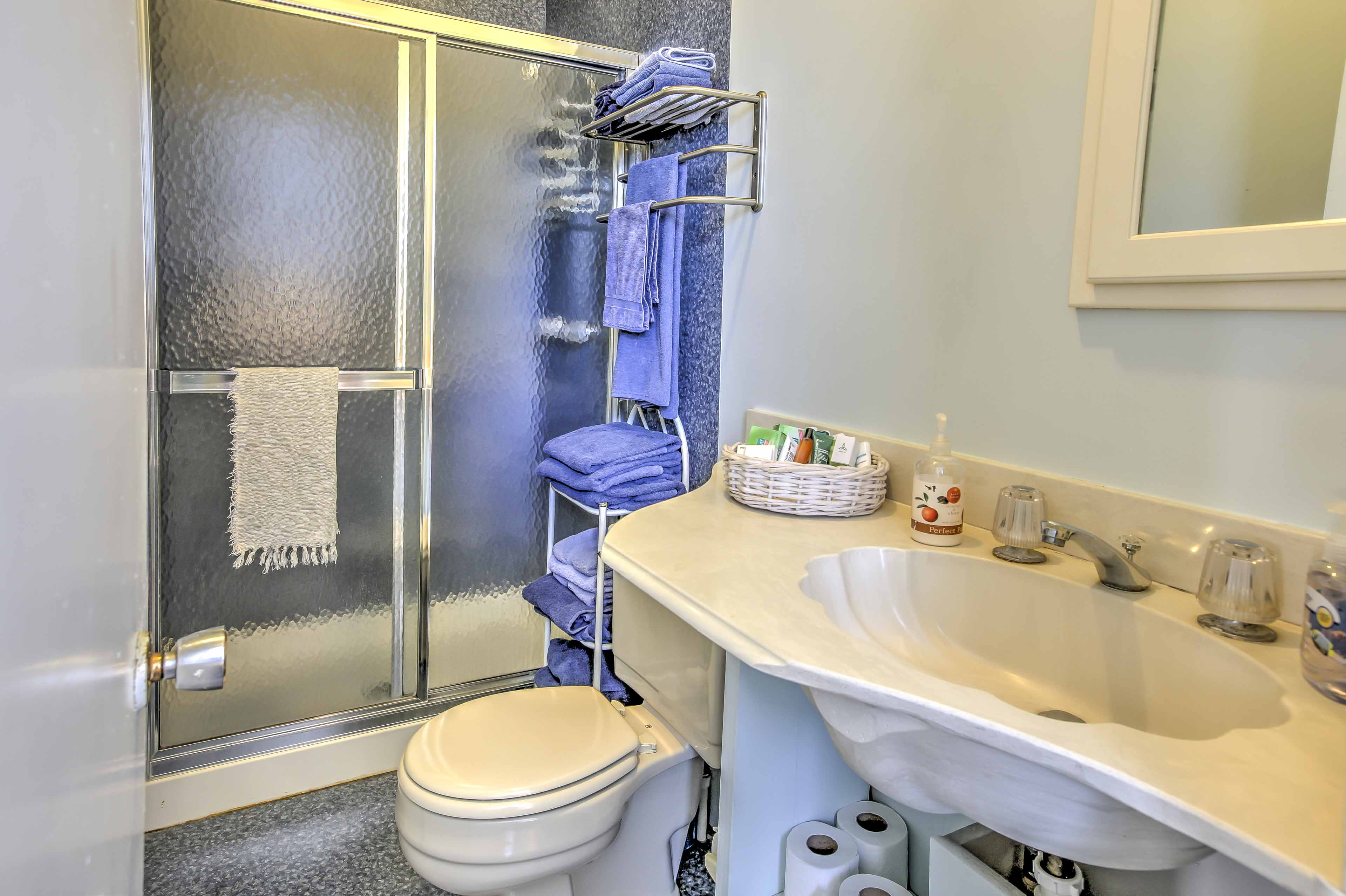 The bathroom provides a space to clean up after the beach & a shower/tub combo.