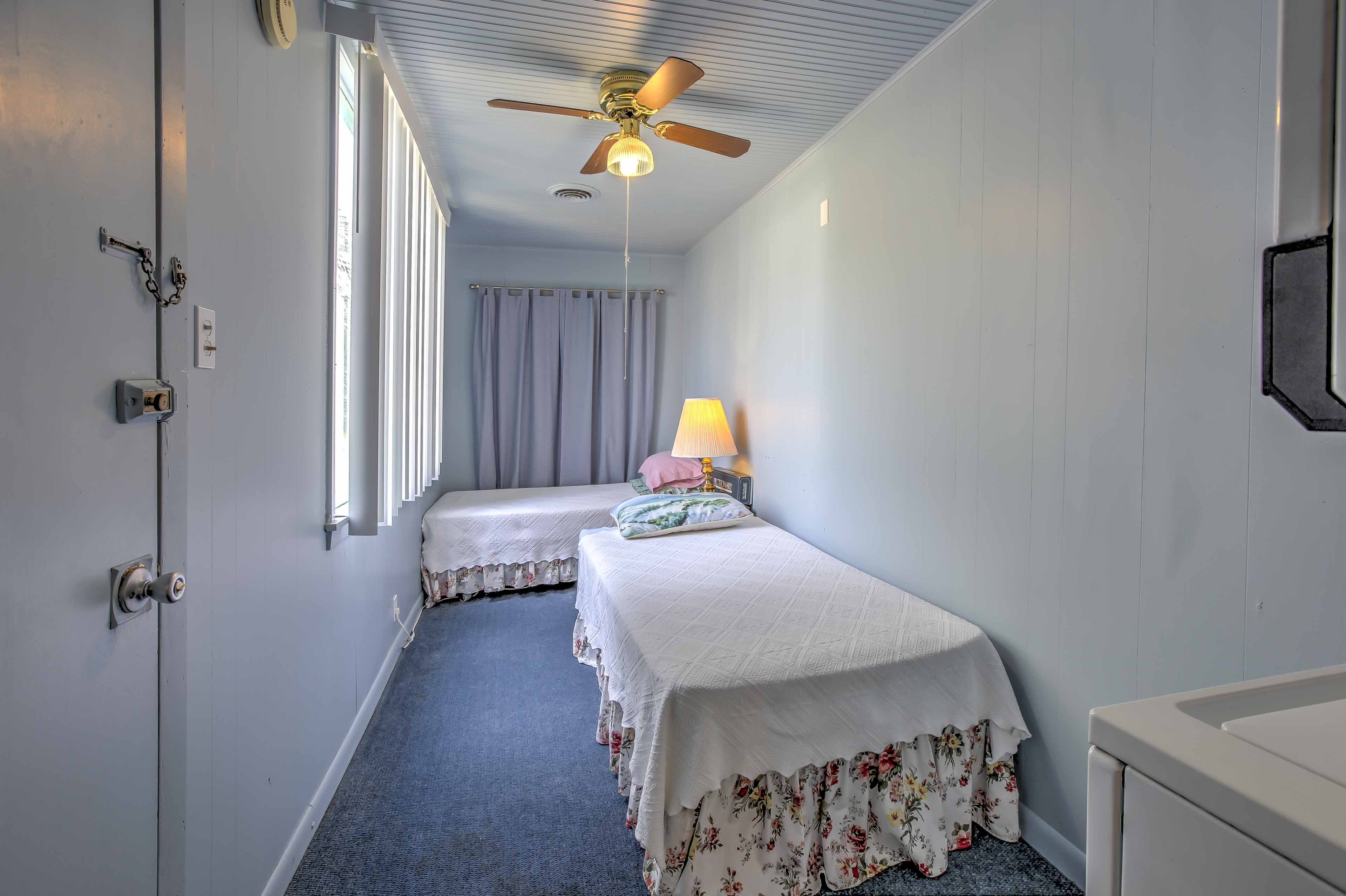 There are 2 twin-sized beds in an additional room.
