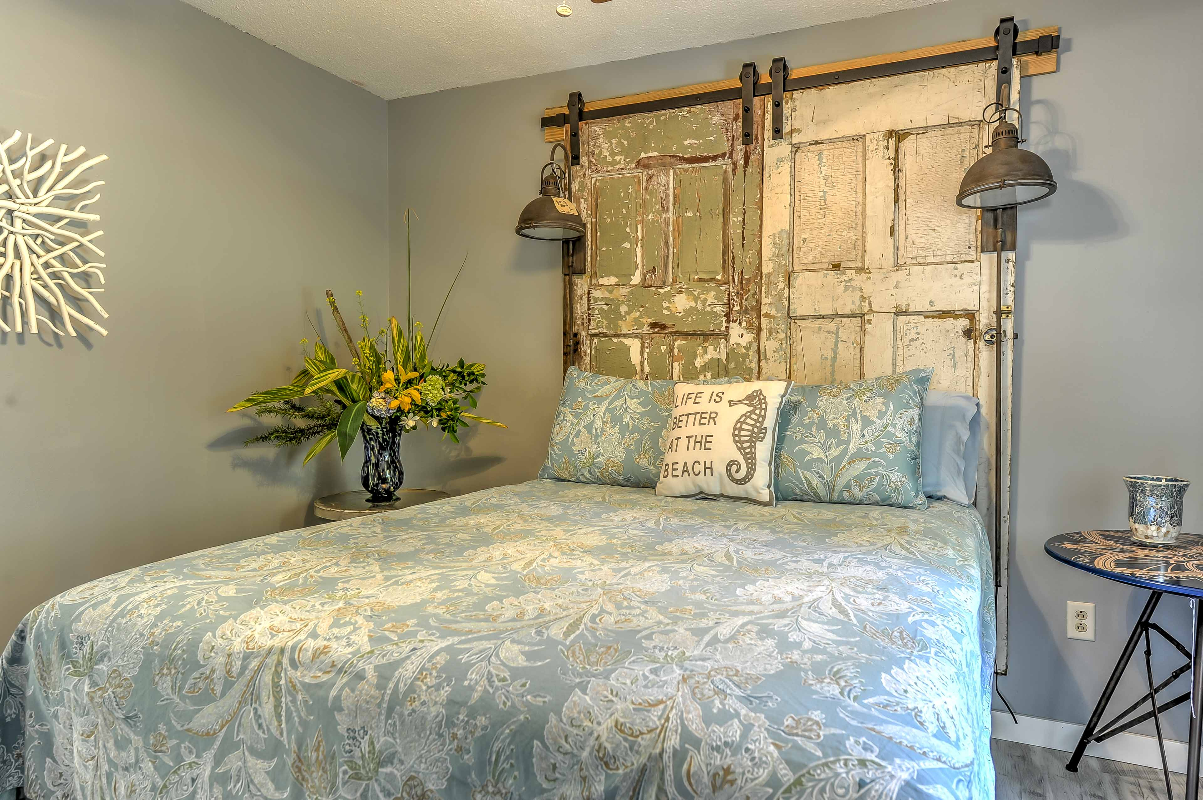 Drift into sweet dreams in this coastal-themed bedroom.