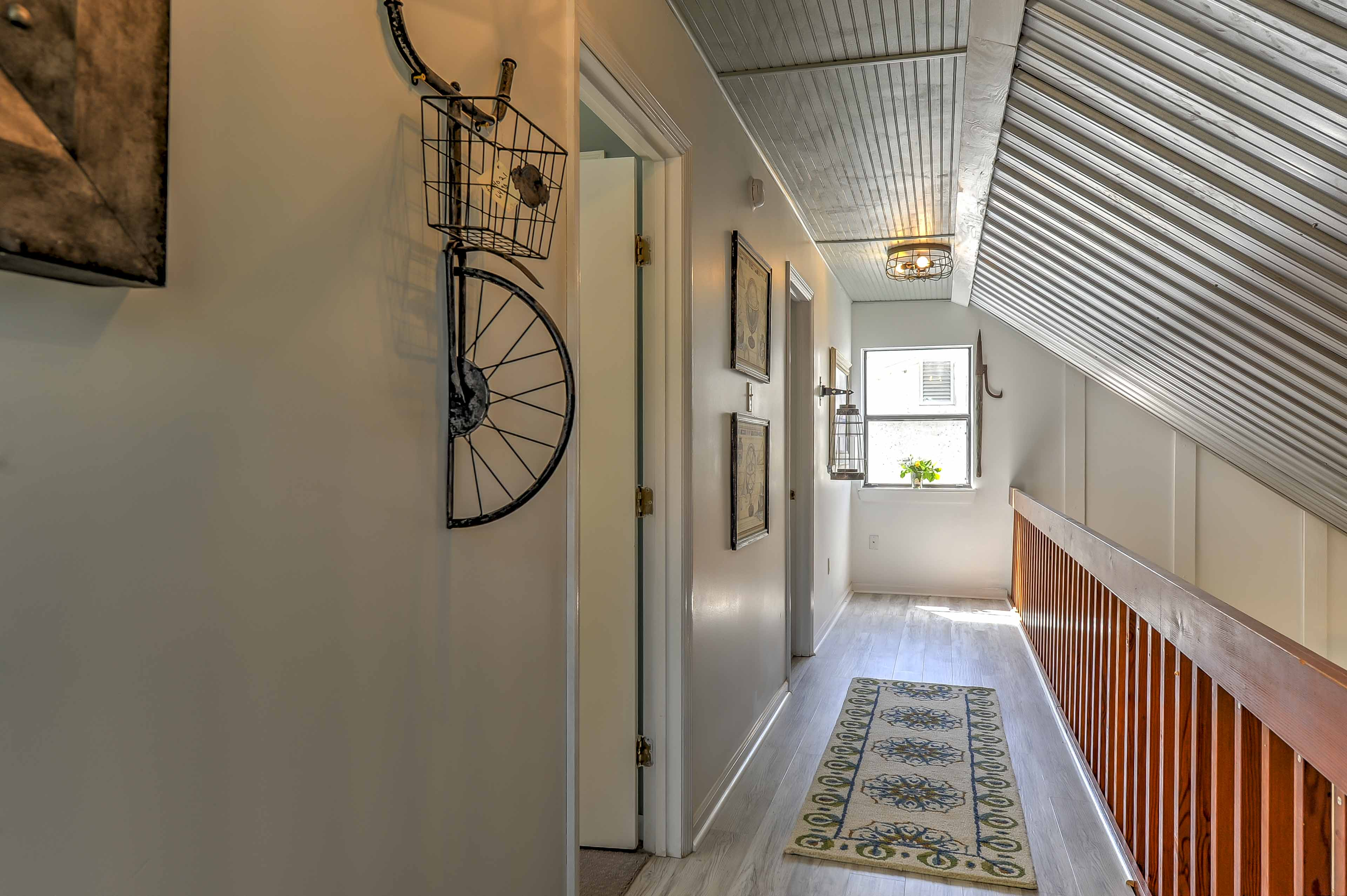 Head upstairs to access the other 2 bedrooms.