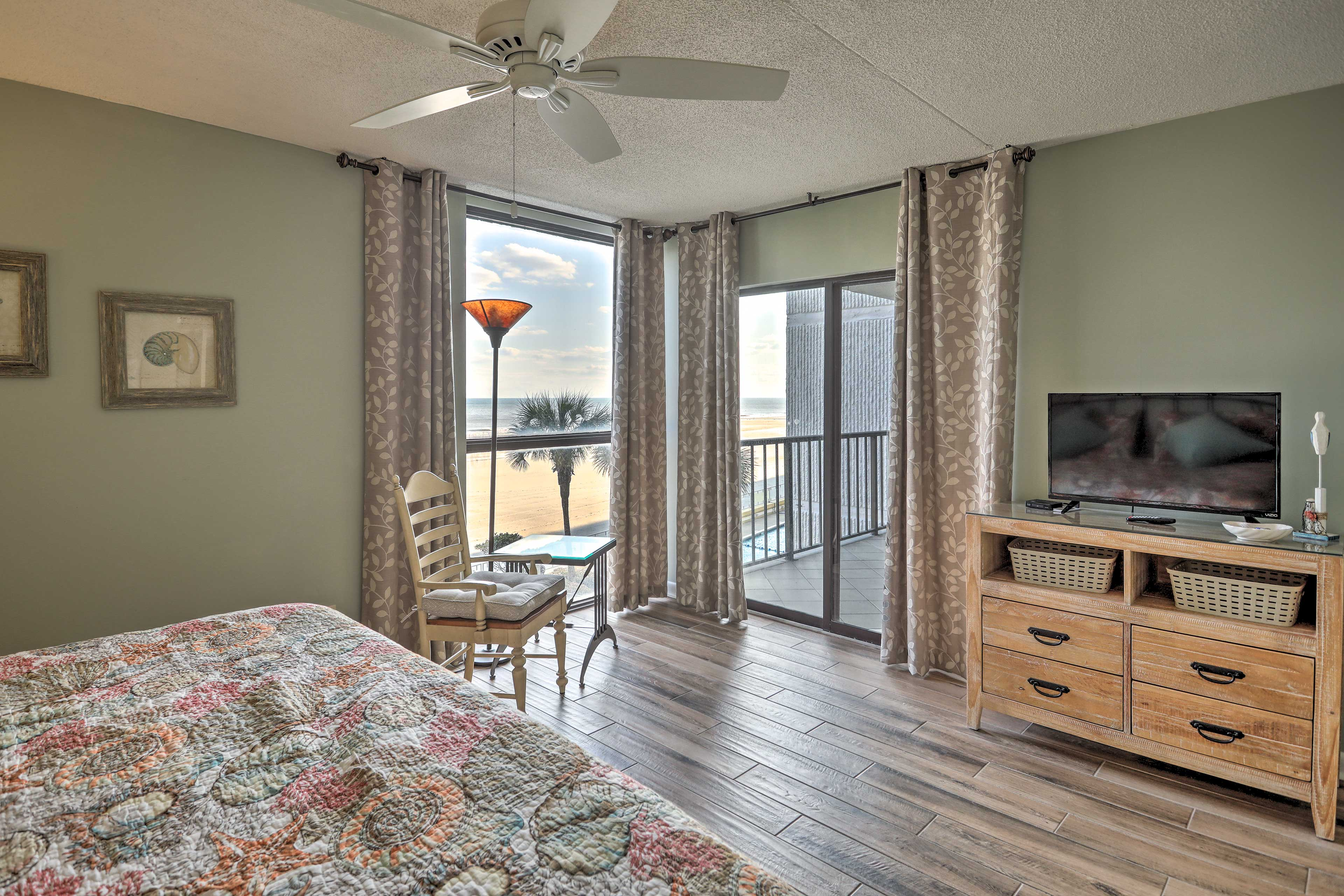 Catch the beachfront view from the comfort of bed.