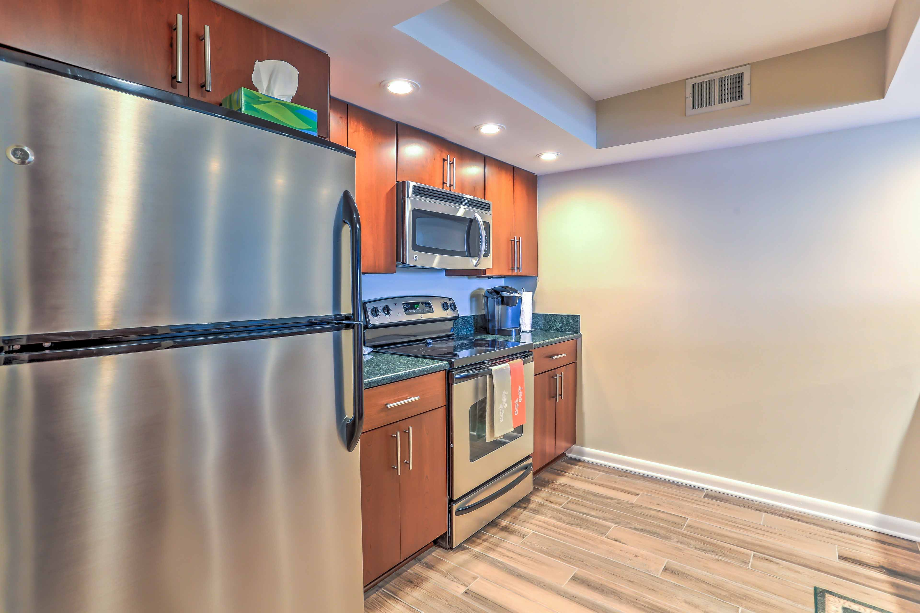The kitchen offers stainless steel appliances and granite counter tops.