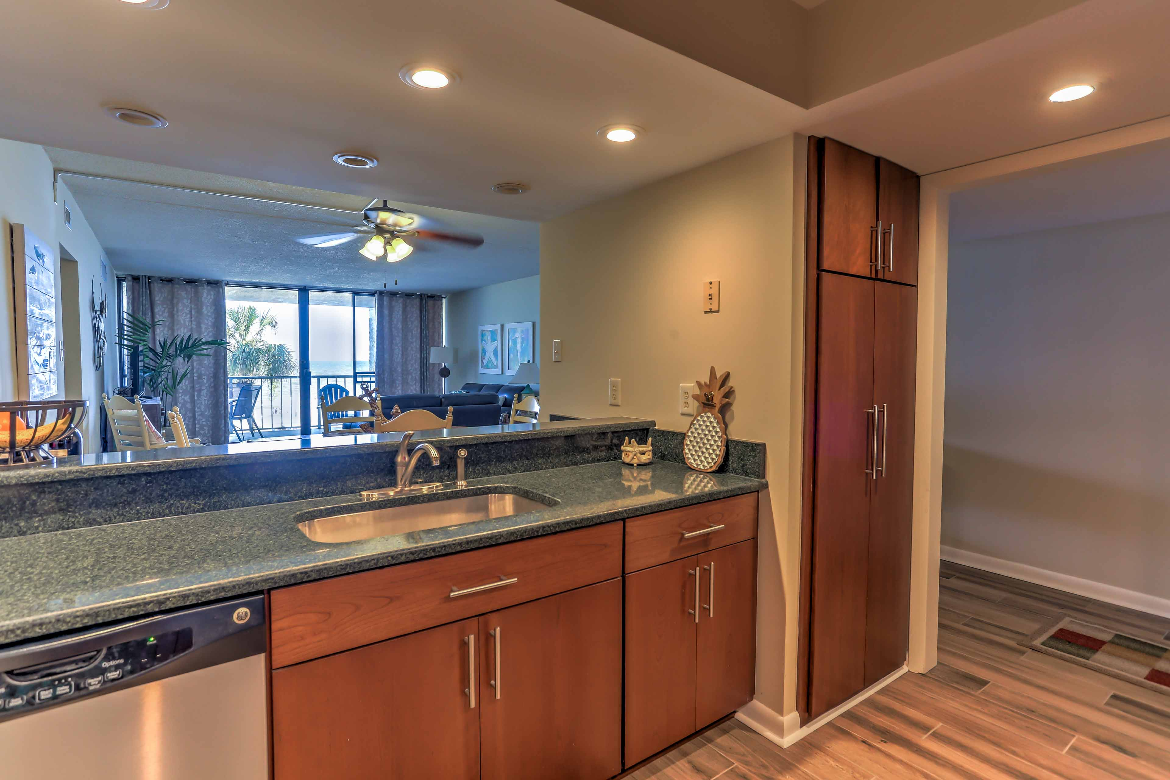 The kitchen is tastefully furnished with wood cabinets.