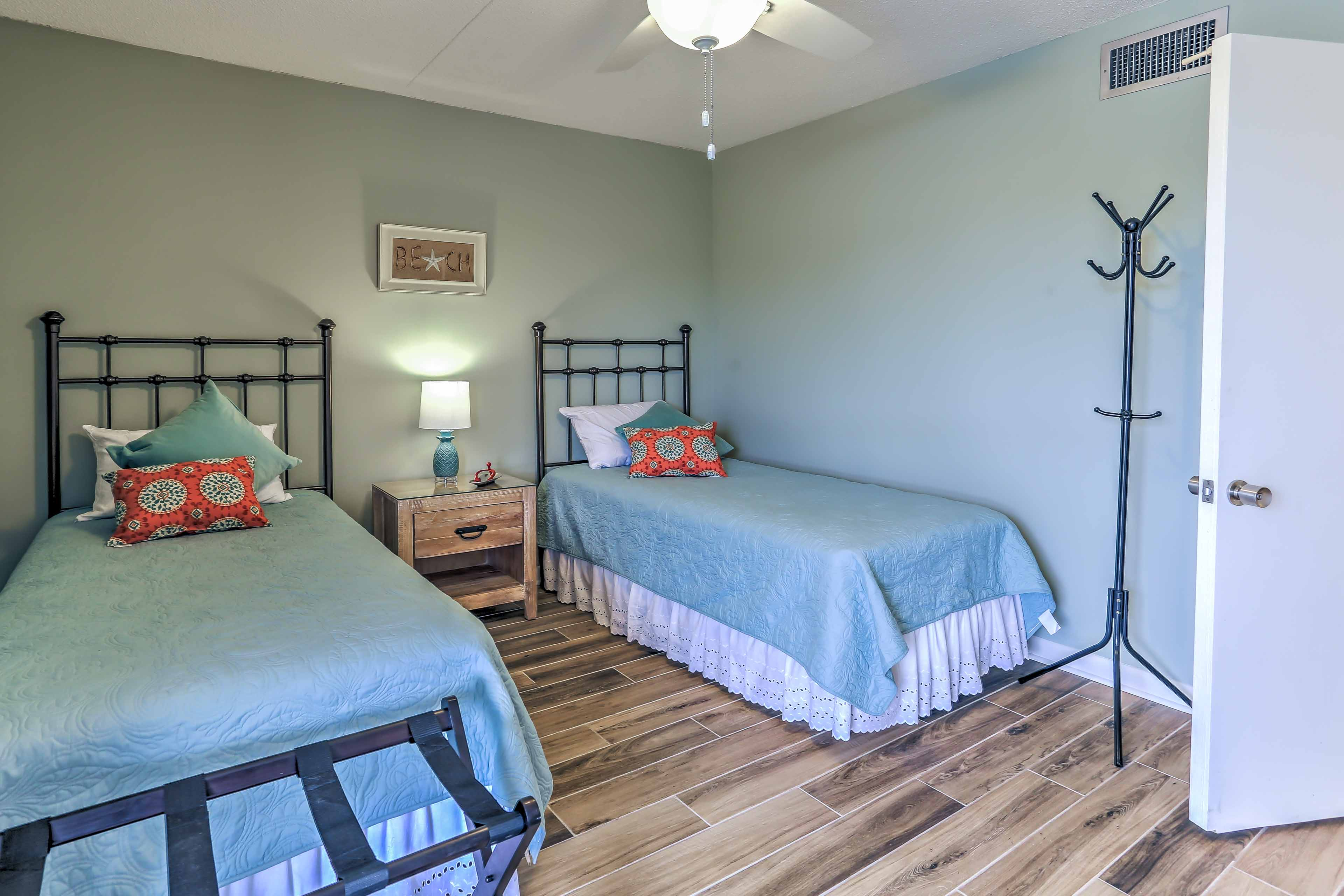 Wake up feeling ready for a new day in the 2nd bedroom with 2 twin beds.
