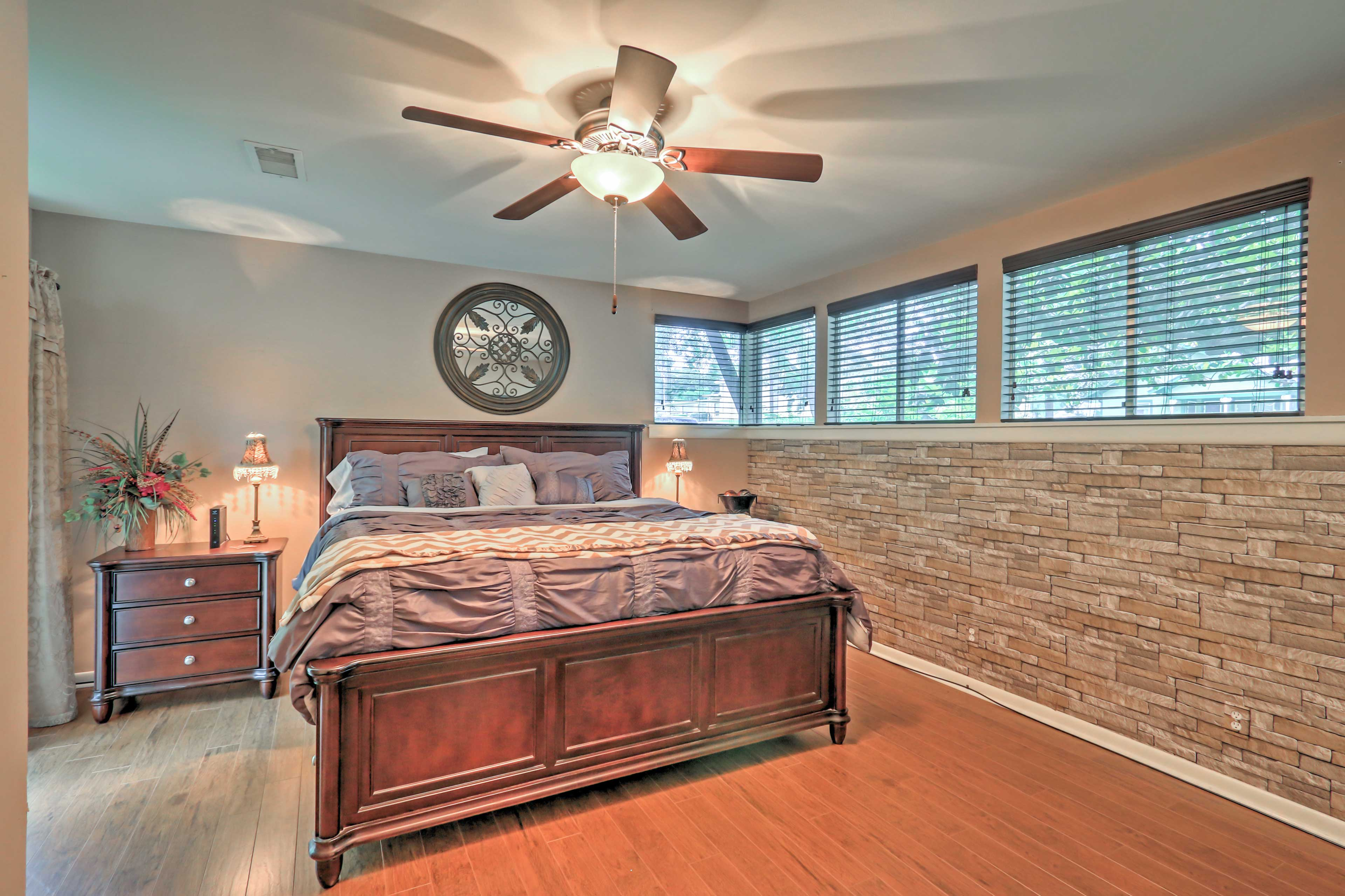 The master bedroom features a king bed and direct access to outside.