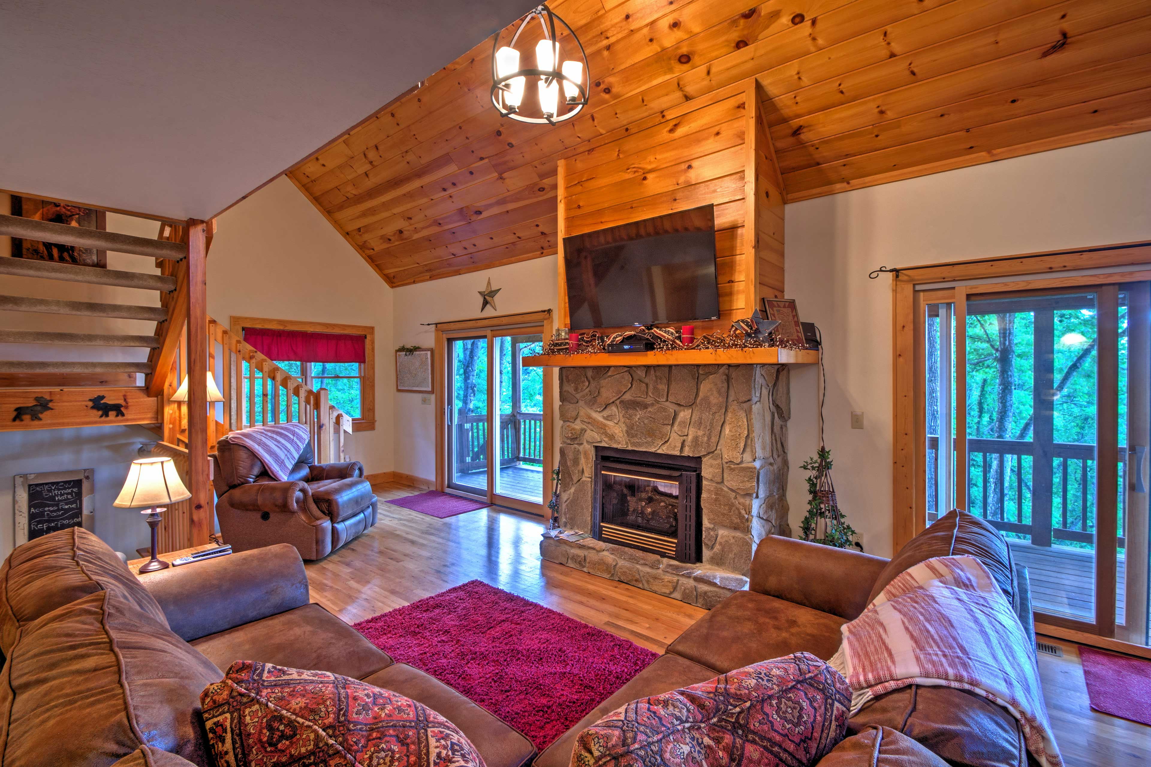 The living area features a stone propane insert fireplace and flat-screen TV.