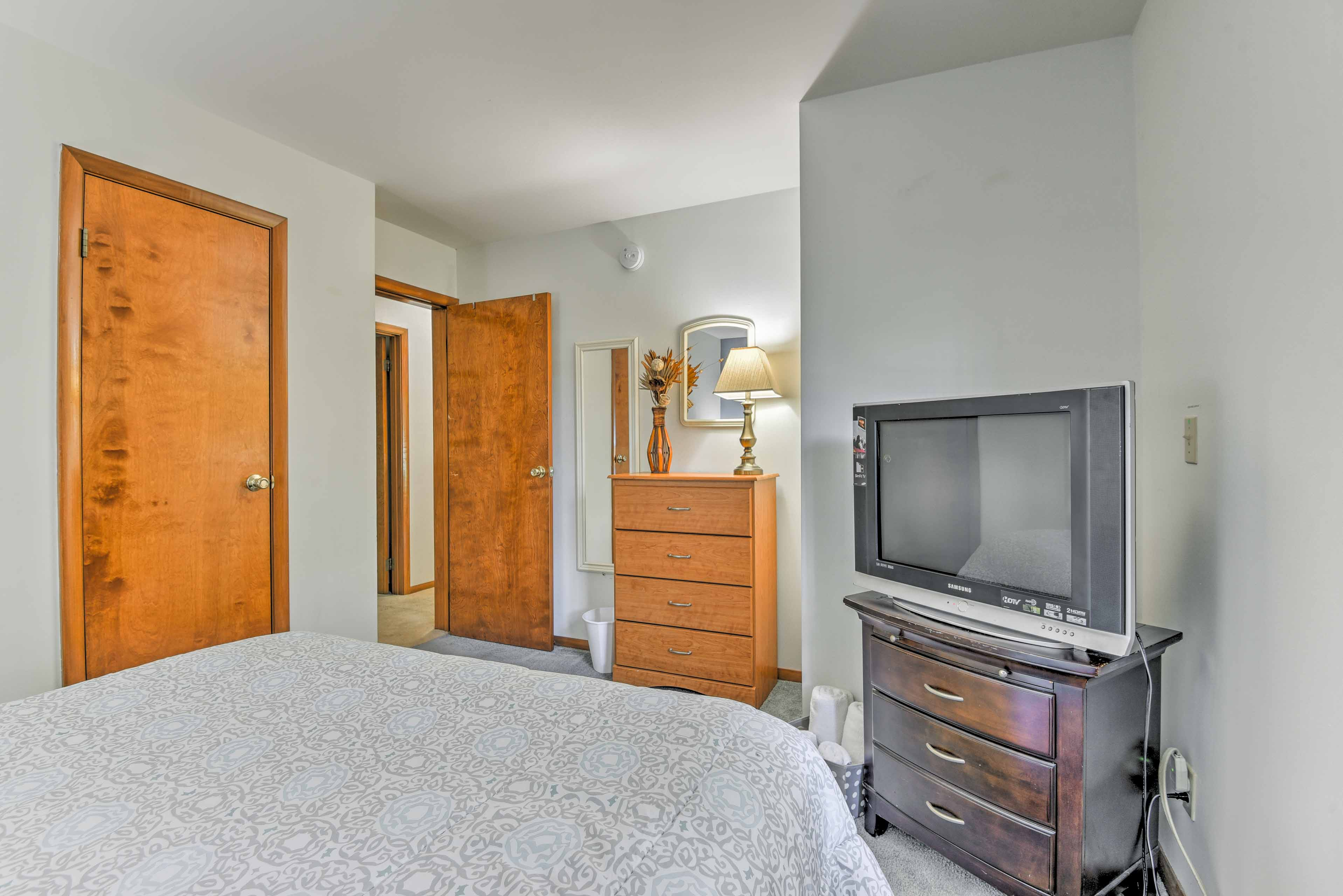 This bedroom includes a cable TV.