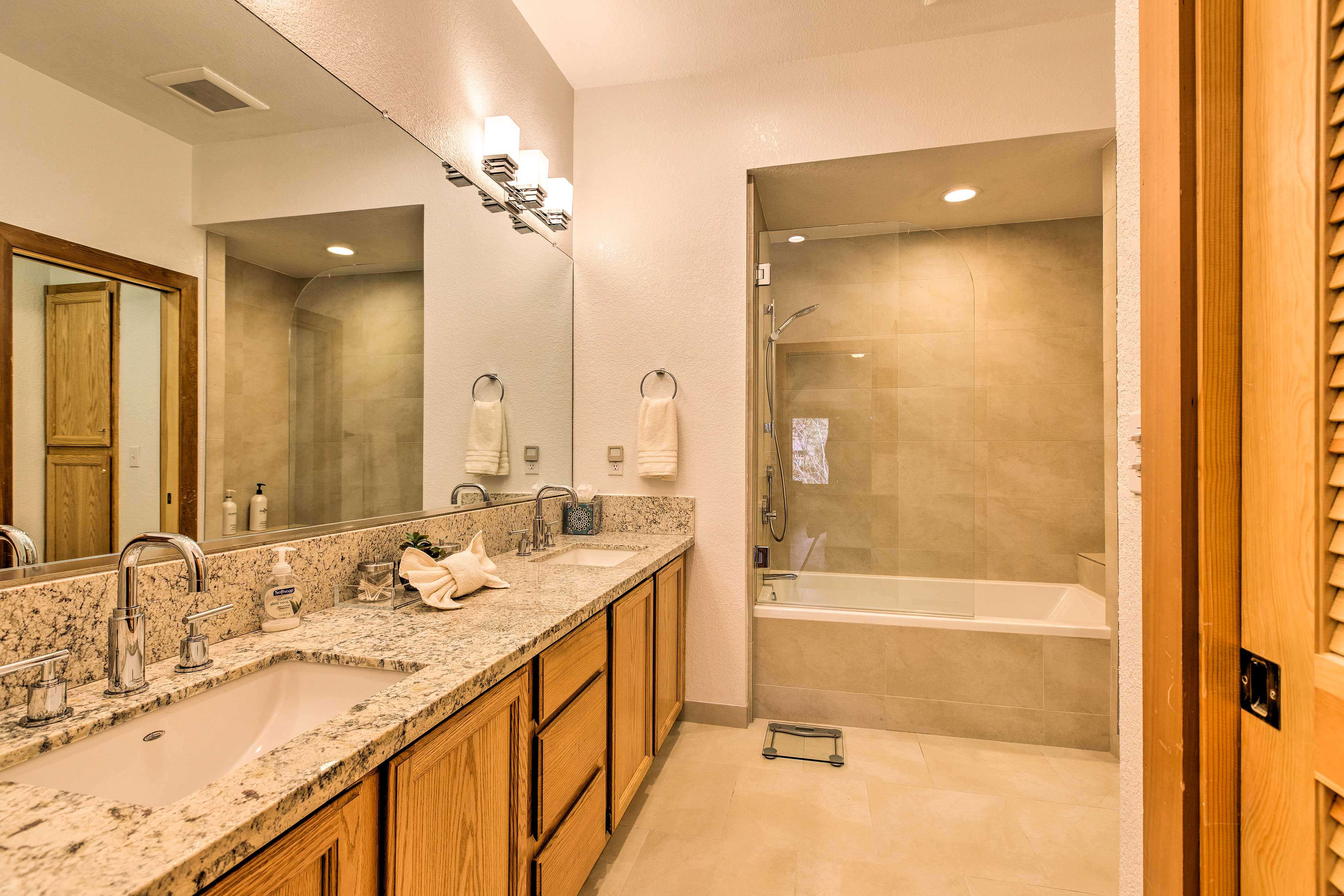 The en-suite master bathroom provides a double vanity and a shower/tub combo.