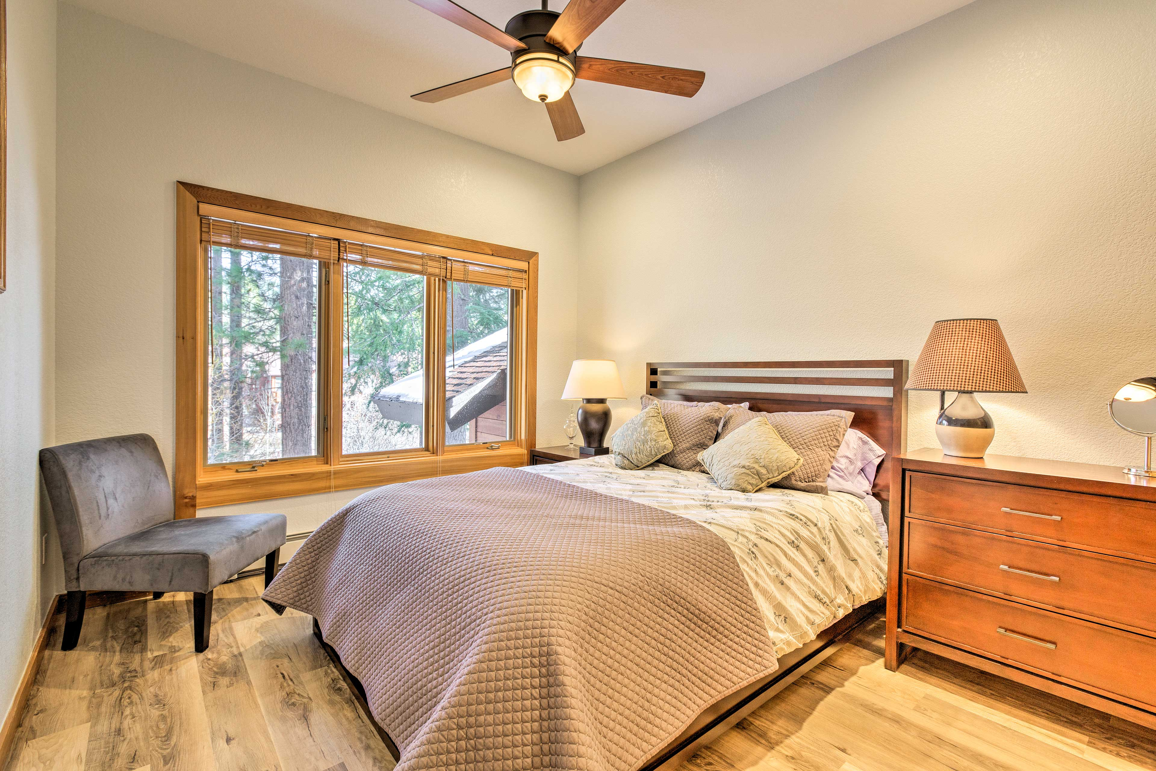 Two guests can share the comfort of this plush queen bed.