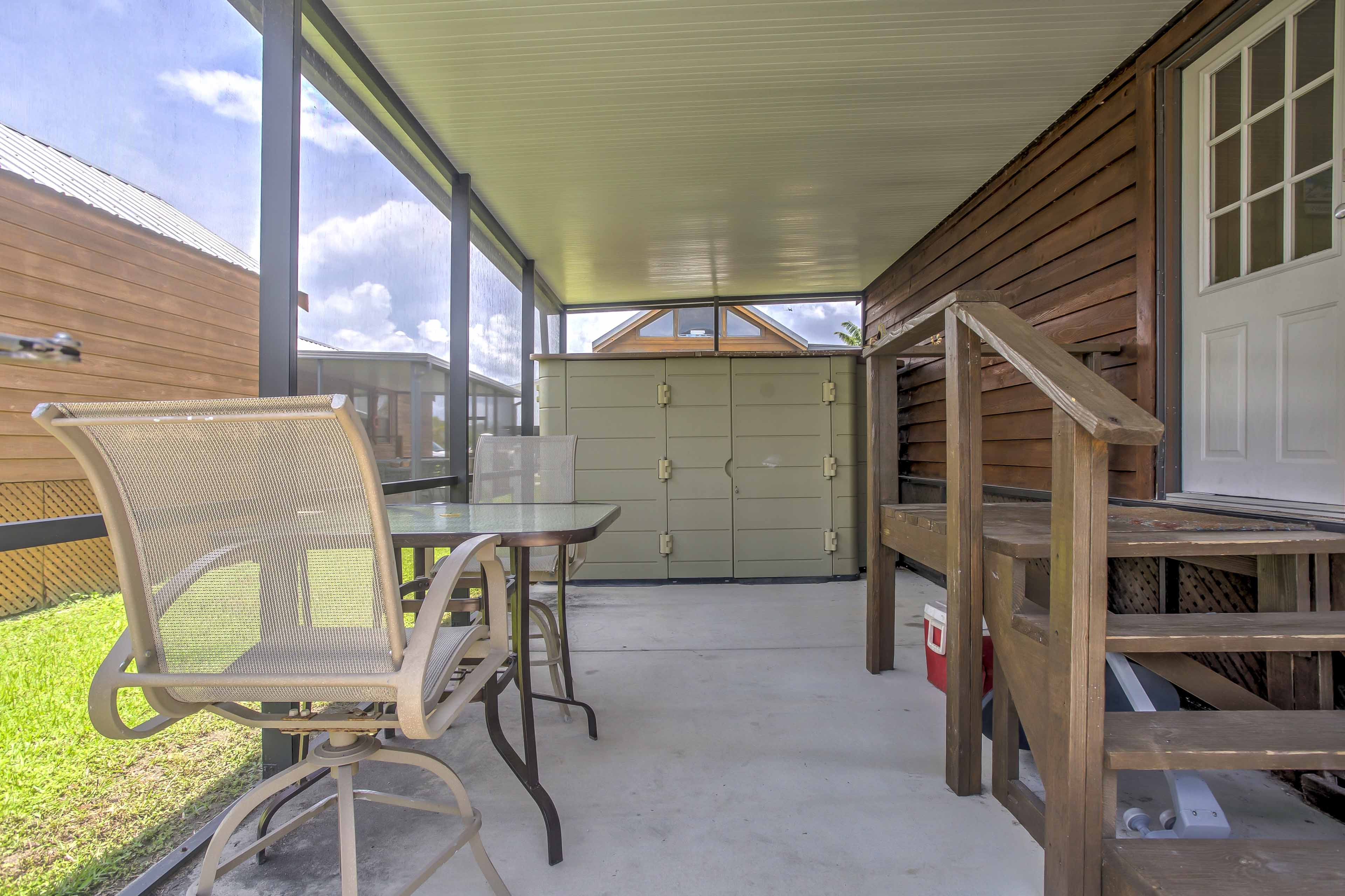 Escape the heat while still enjoying the sunshine from the screened-in porch.