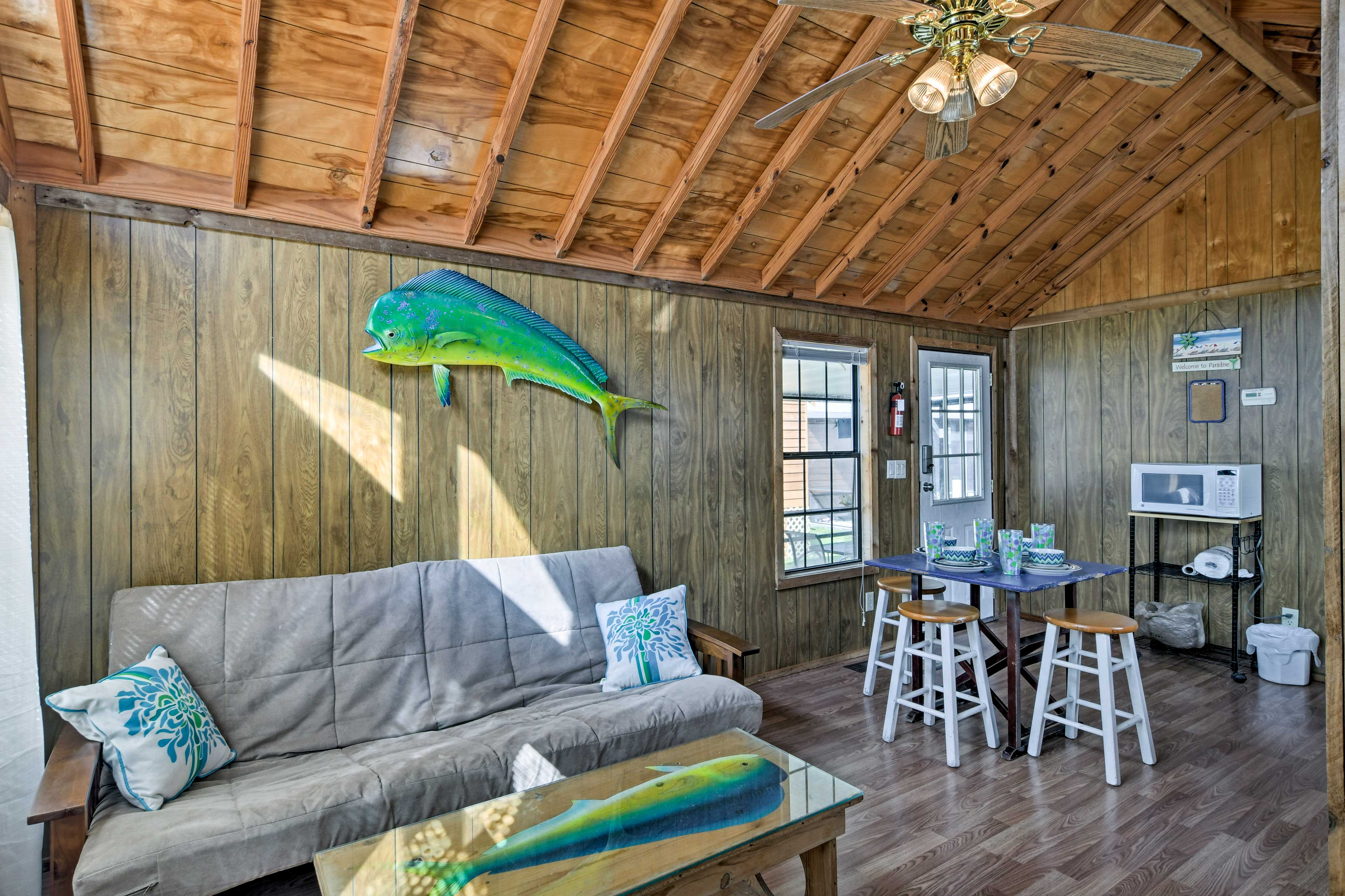 The interior is tastefully outfitted with wood paneling and coastal-themed decor.