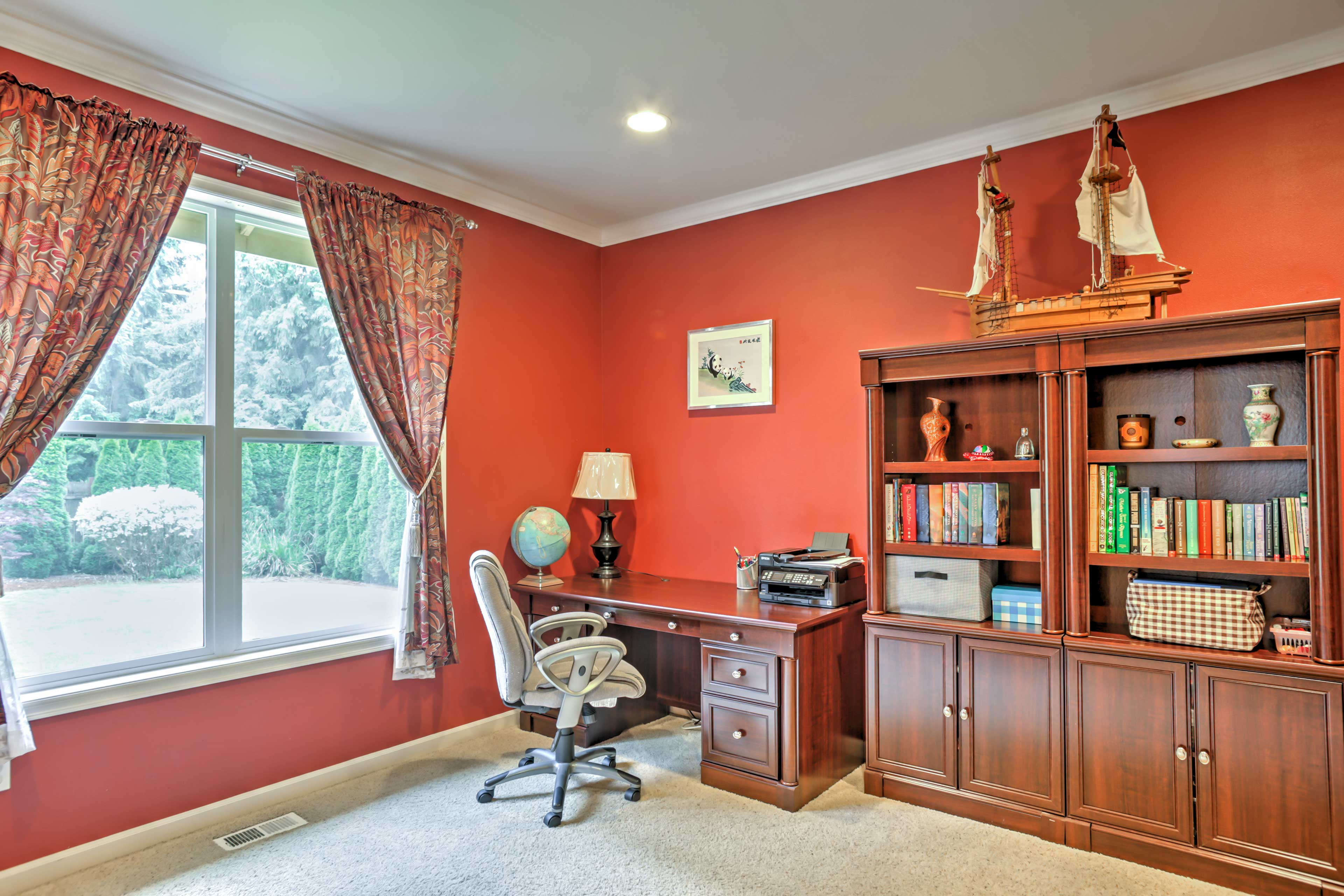 The office offers a great desk space, as well as a futon.